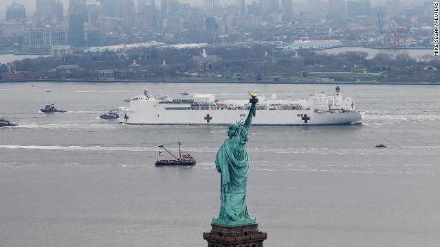 The USNS Comfort passes the Statue of Liberty as it enters New York Harbor during the outbreak of the coronavirus disease in New York City on March 30.