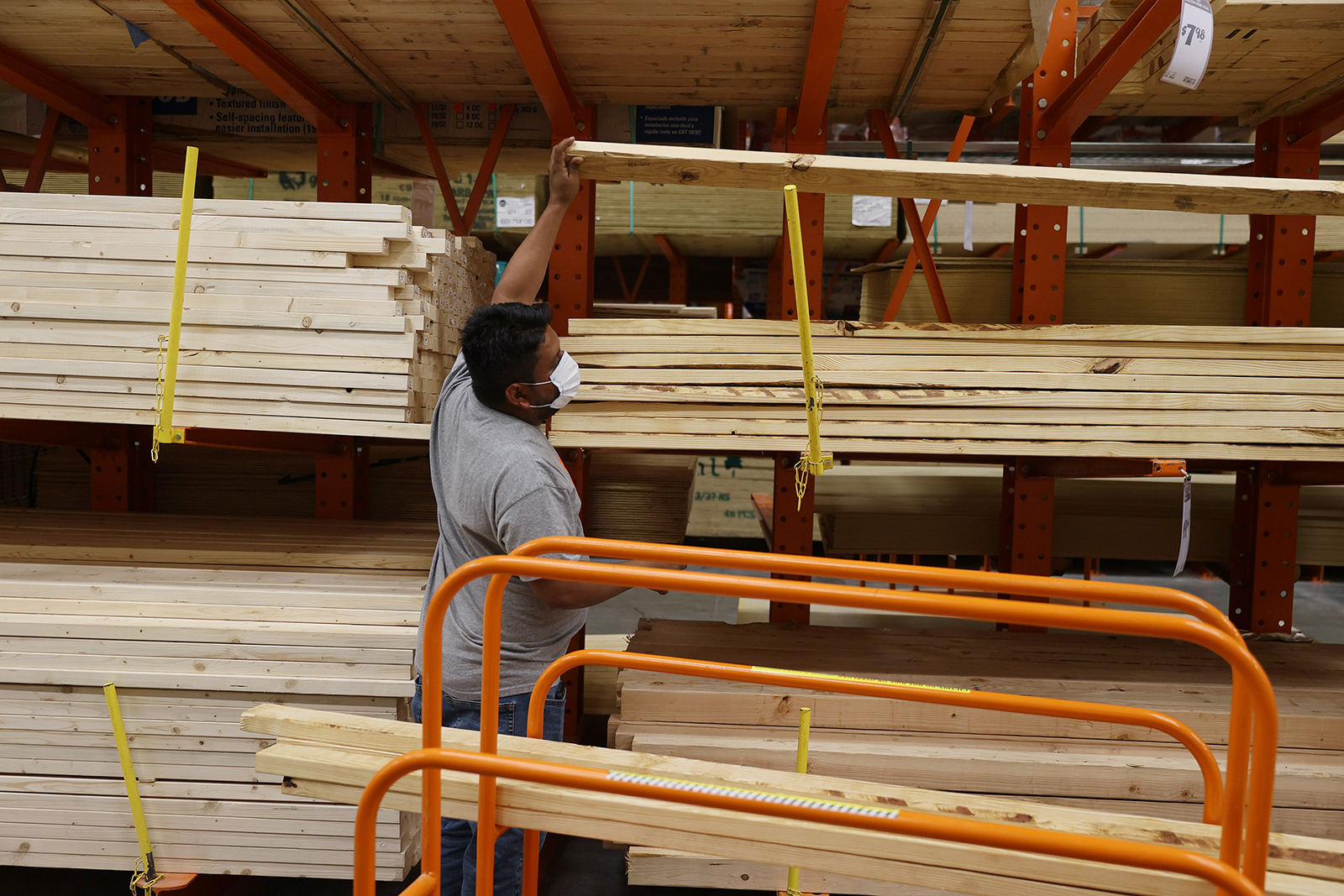 Enrique Matamoros shops for lumber at a Home Depot store on May 27, in Doral, Florida.