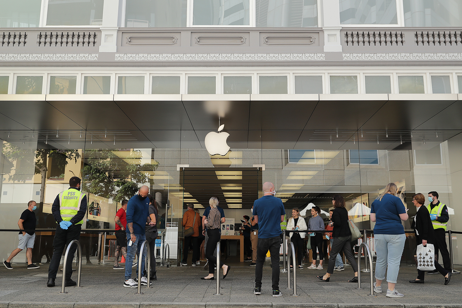 Apple staff ask health questions of people entering the Apple store in Perth, Australia, on Monday, May 18.