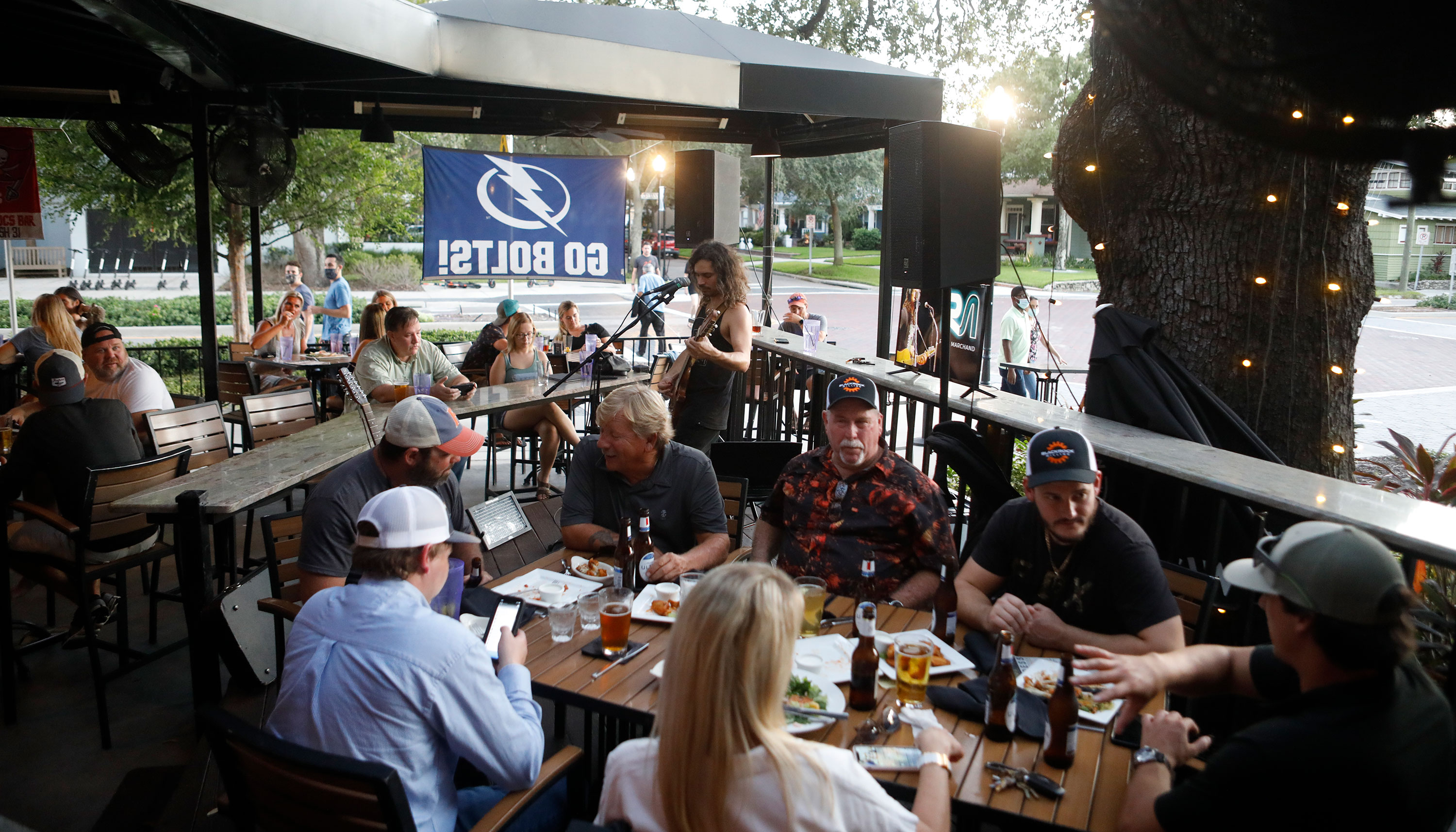 Patrons eat dinner at Irish 31 on the first day of full capacity seating on September 25 in Tampa, Florida.
