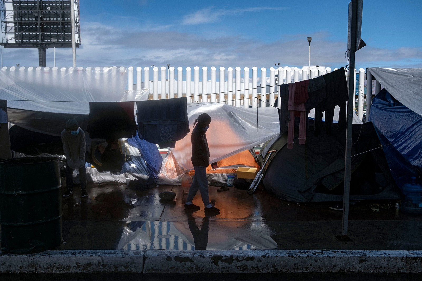 A migrant girl walks at an improvised camp outside El Chaparral crossing port as her and other wait for US authorities to allow them to start their migration process in Tijuana, Baja California state, Mexico, on March 11.