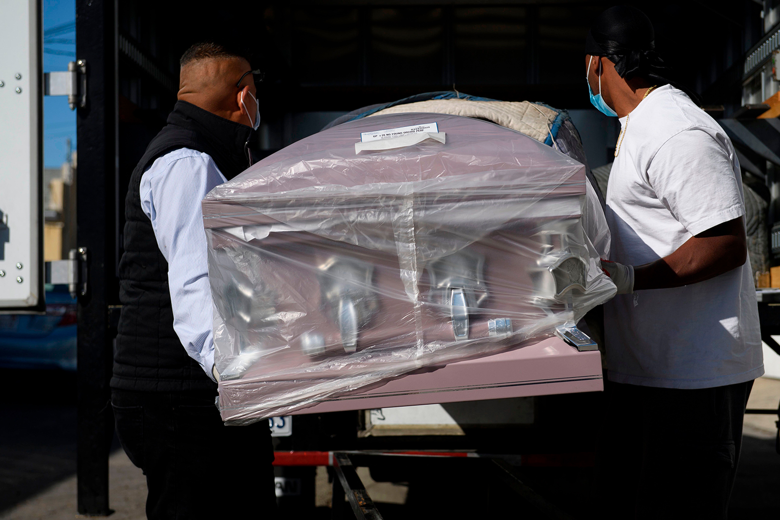 An empty casket is delivered amid a surge of Covid-19 deaths to the Continental Funeral Home in East Los Angeles, California, on December 31, 2020.
