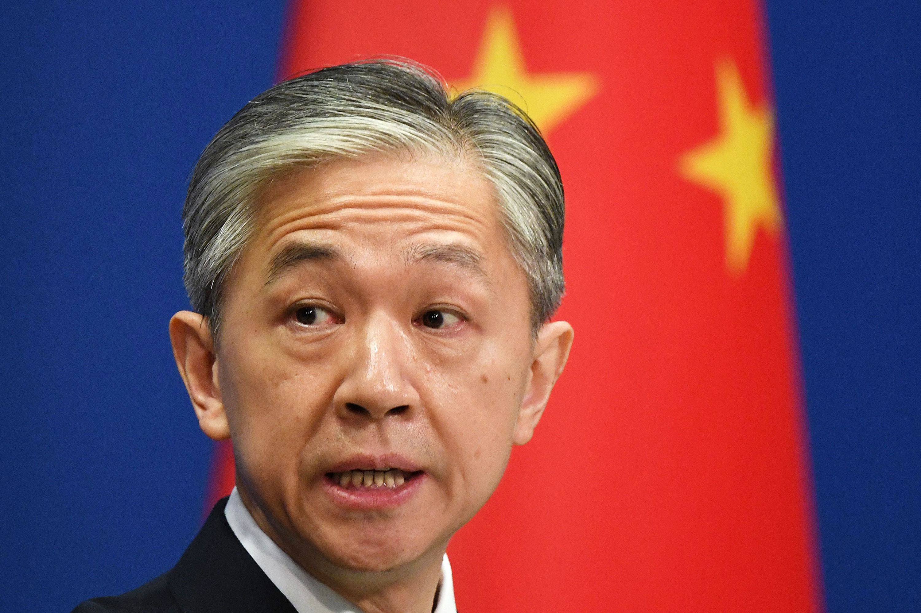 Chinese Foreign Ministry spokesman Wang Wenbin speaks at a daily briefing on July 24 in Beijing.