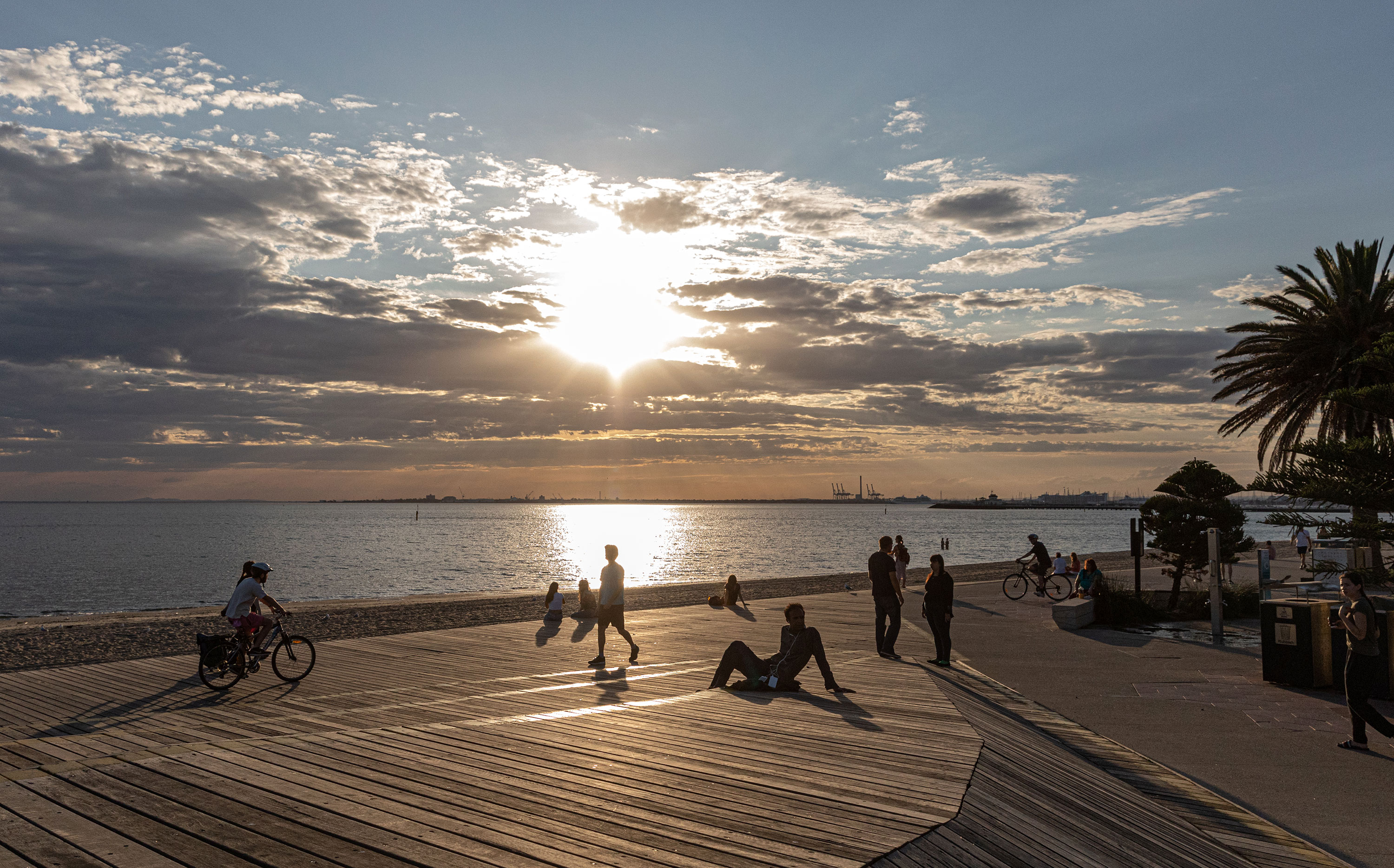 People spend time at St Kilda Beach in Melbourne, Australia on March 28.