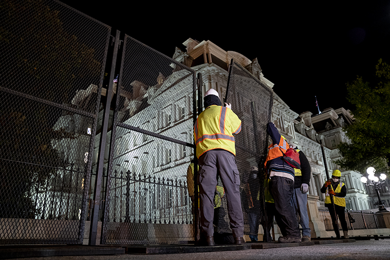 Construction workers set up additional fencing near the White House in Washington, D.C., U.S., on Monday, Nov. 2, 2020.
