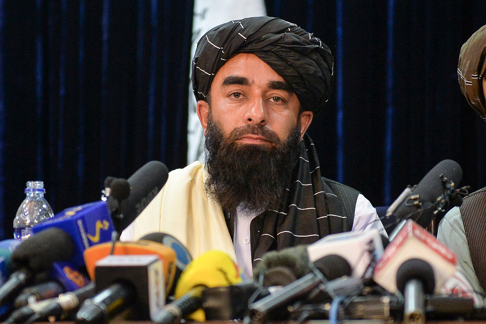 Taliban spokesperson Zabihullah Mujahid looks on as he addresses the first press conference in Kabul on August 17.