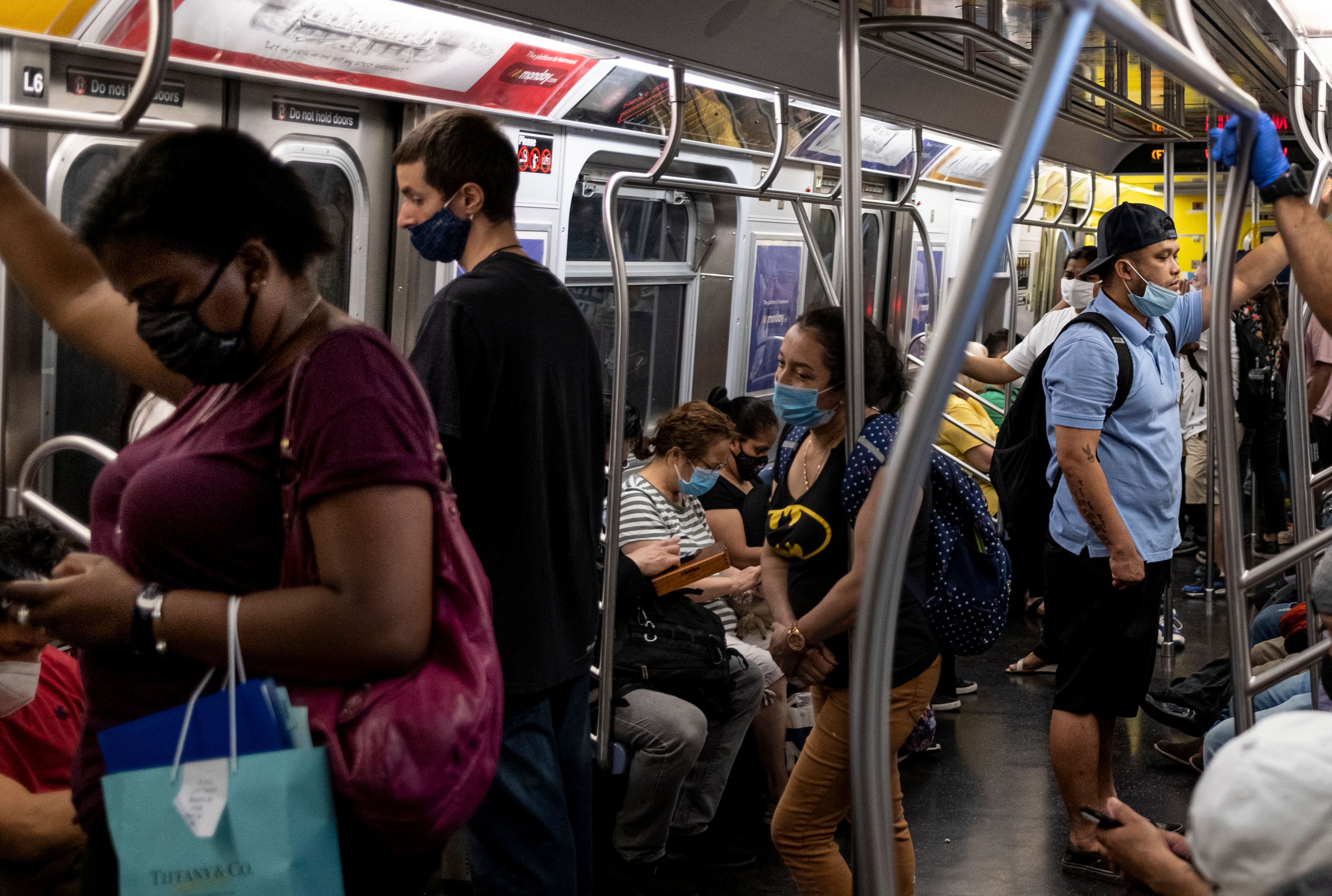 People ride the subway in New York on July 16.