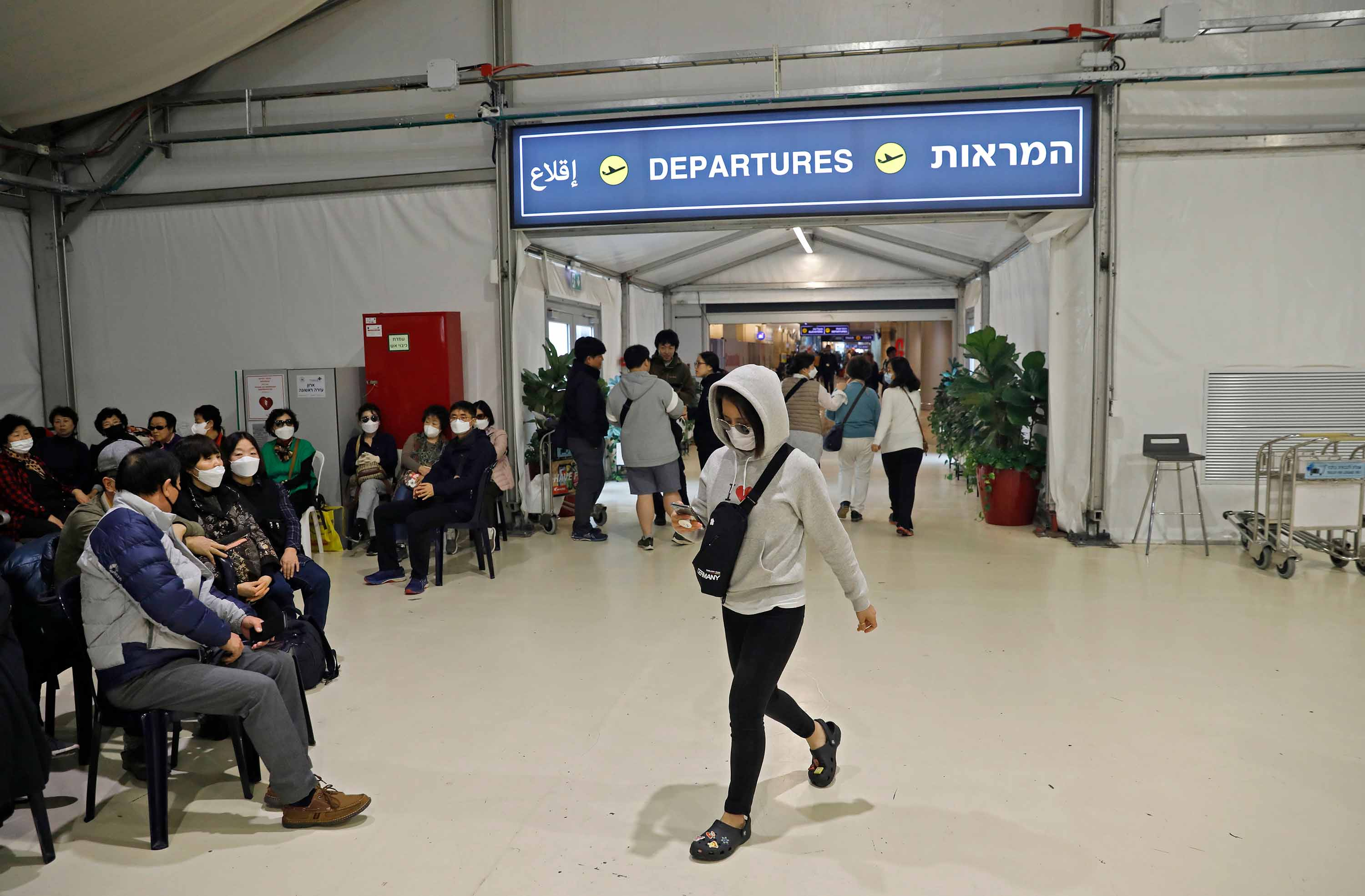 South Korean tourists leaving Israel are pictured at a pavillon separated from the main terminal of Ben Gurion International Airport near Tel Aviv on Monday.