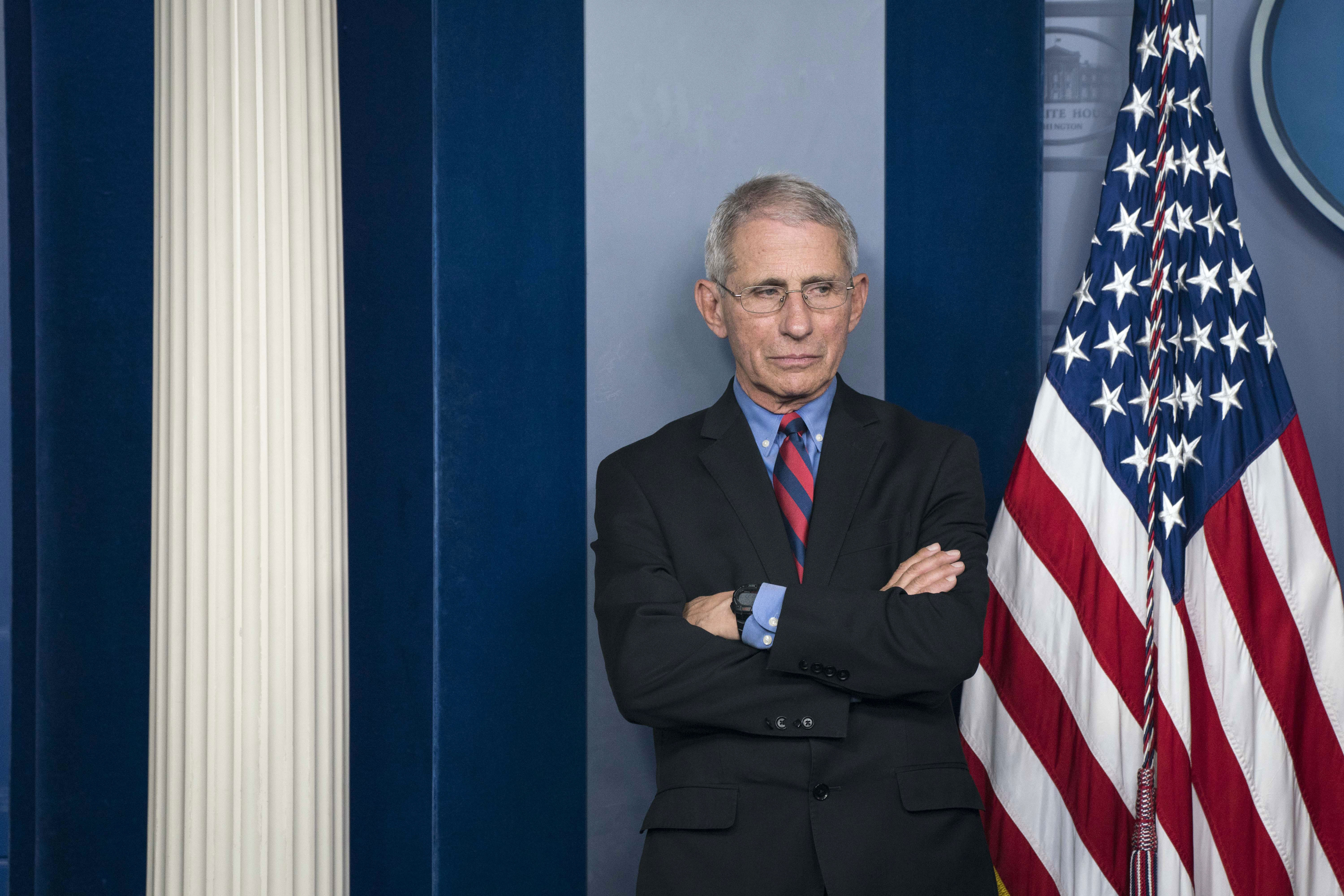 Dr. Anthony Fauci attends a news conference at the White House on March 25.