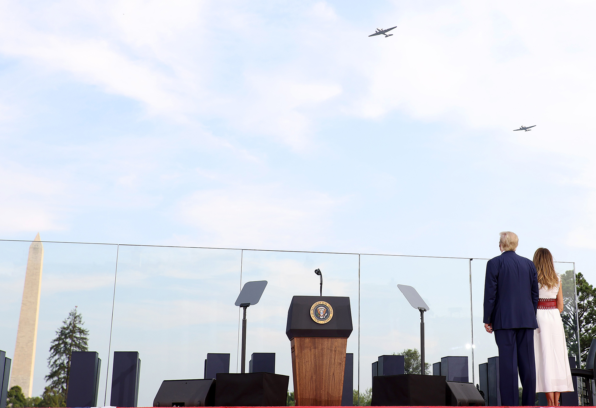 President Donald Trump and first lady Melania Trump watch a flyover performance near the White House on July 04, 2020 in Washington, DC.