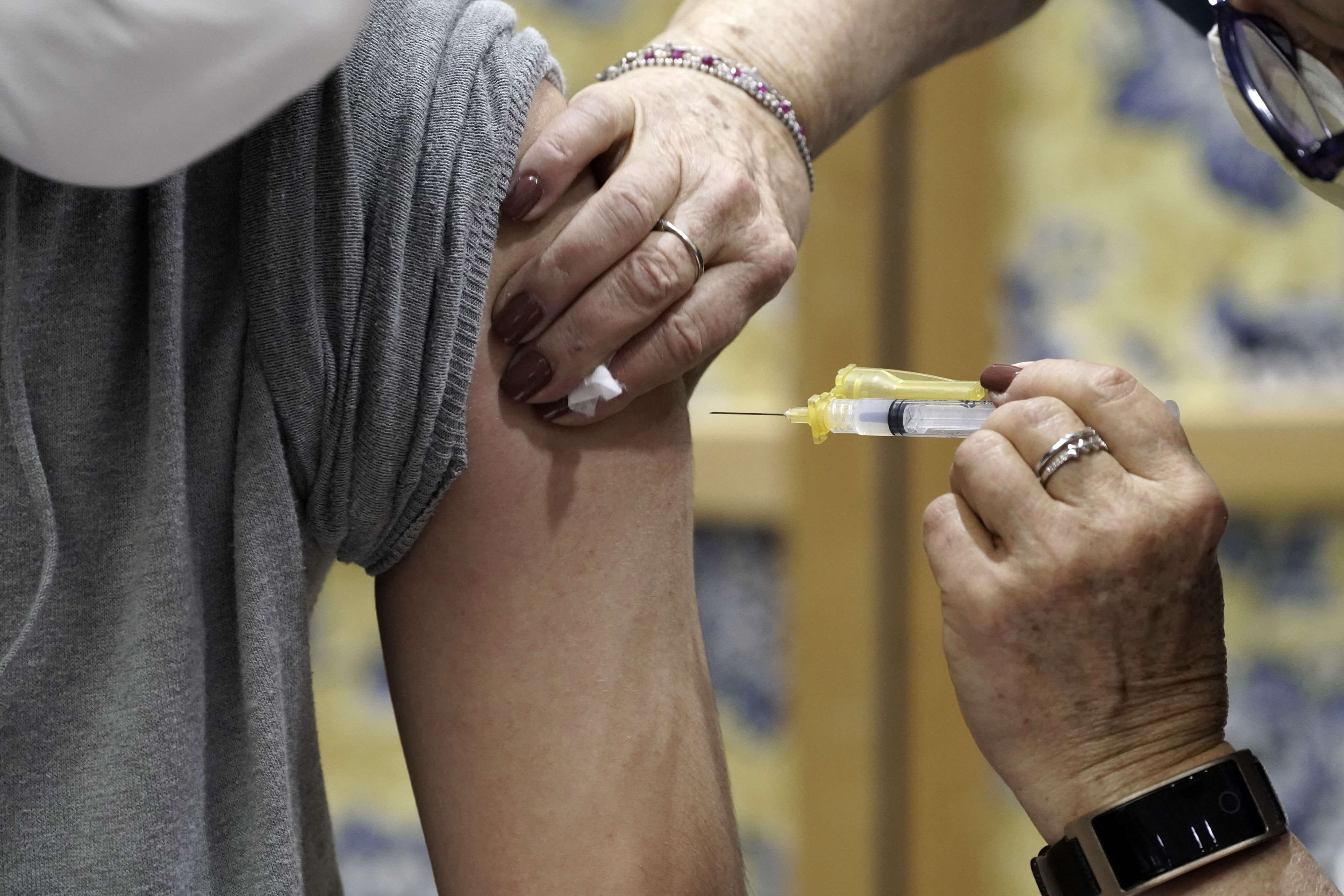A person receives the Moderna Covid-19 vaccine in Tucson, Arizona, on January 15.