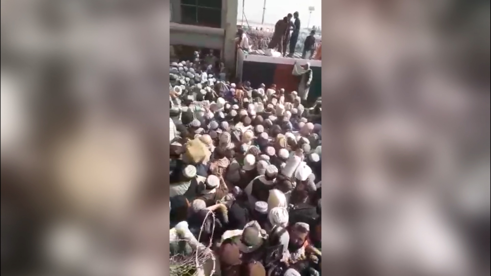 A screen grab taken from video on social media shows a crush of people in Spin Boldak, Afghanistan, at the Afghanistan-Pakistan border on Sept. 1.