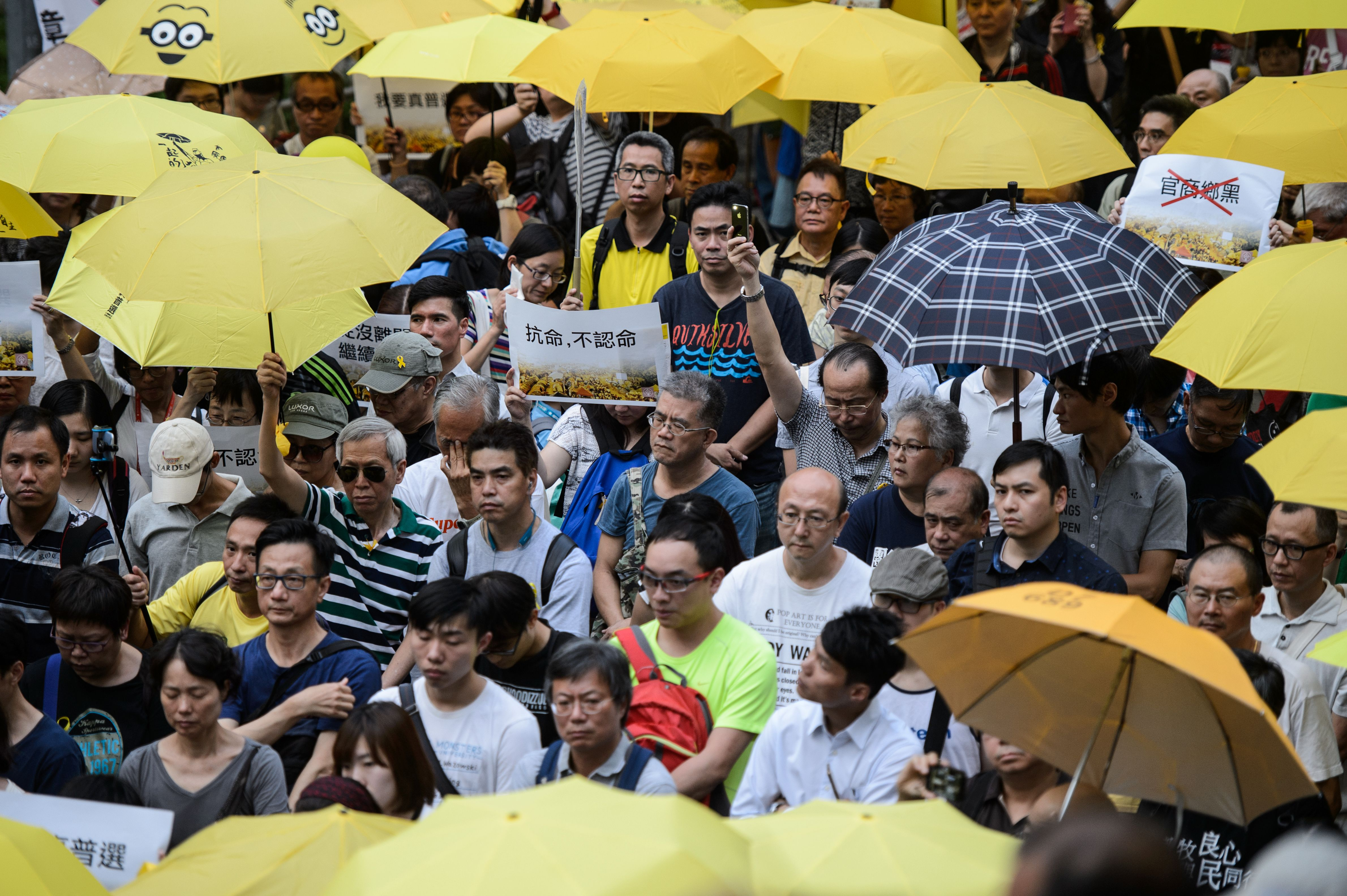 Activists in 2016 holding yellow umbrellas, a symbol of the pro-democracy movement after 2014's Umbrella Revolution.