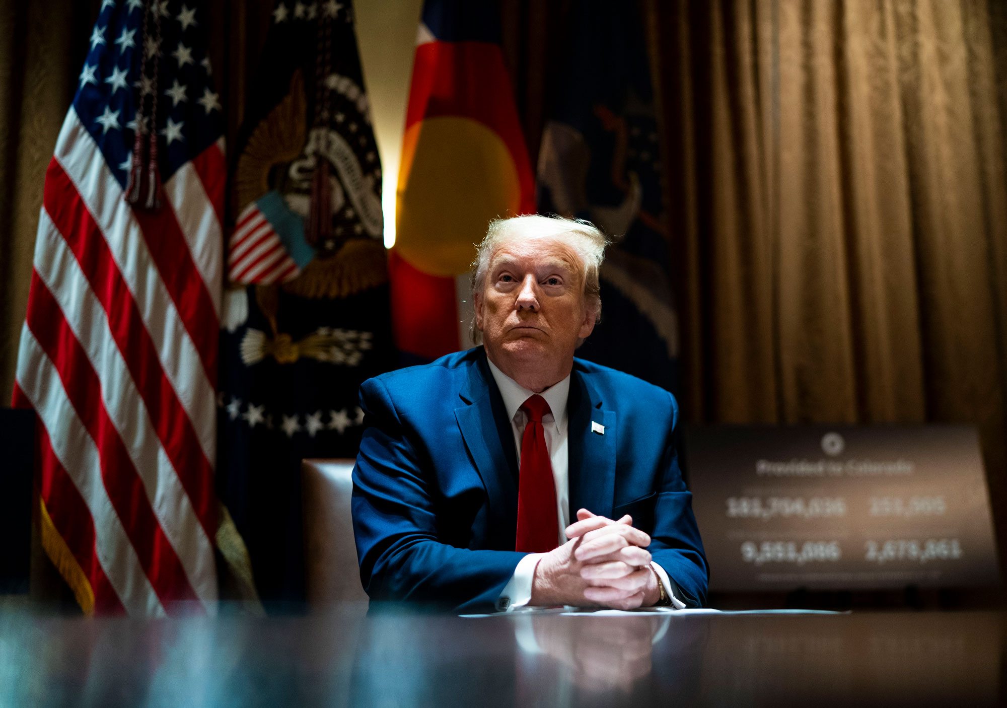 President Donald Trump looks on he as meets with Colorado Governor Jared Polis and North Dakota Governor Doug Burgum in the Cabinet Room of the White House on May 13.