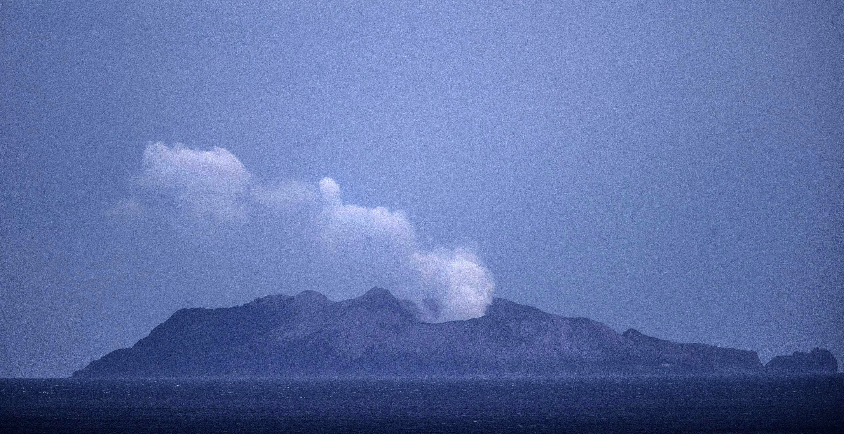 Smoke and ash rises from the volcano on White Island, New Zealand, on December 10, 2019.