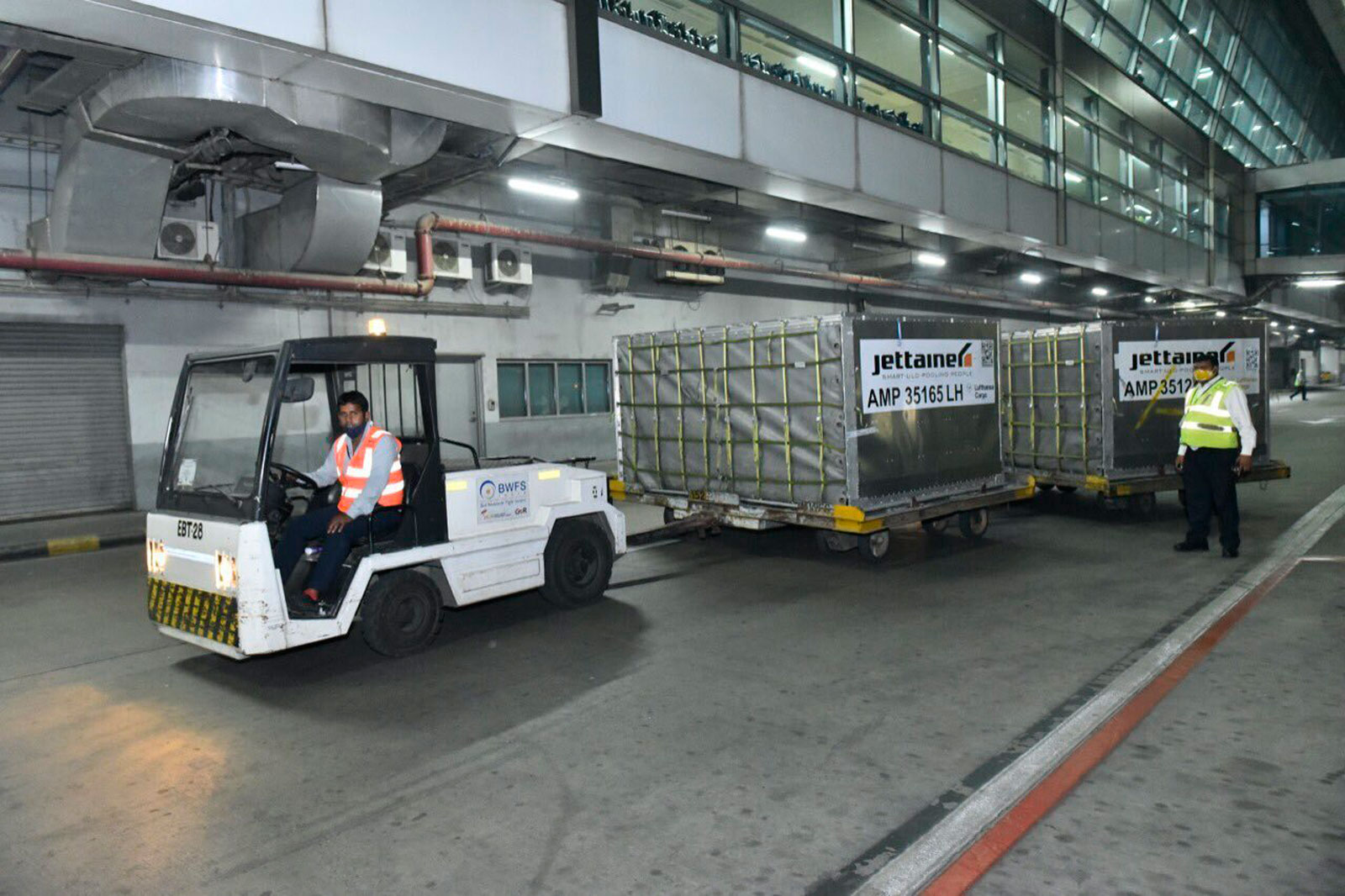 This photograph released by the Indian External Affairs Ministry shows a shipment containing 120 oxygen concentrators that arrived in India from the UK on April 29.