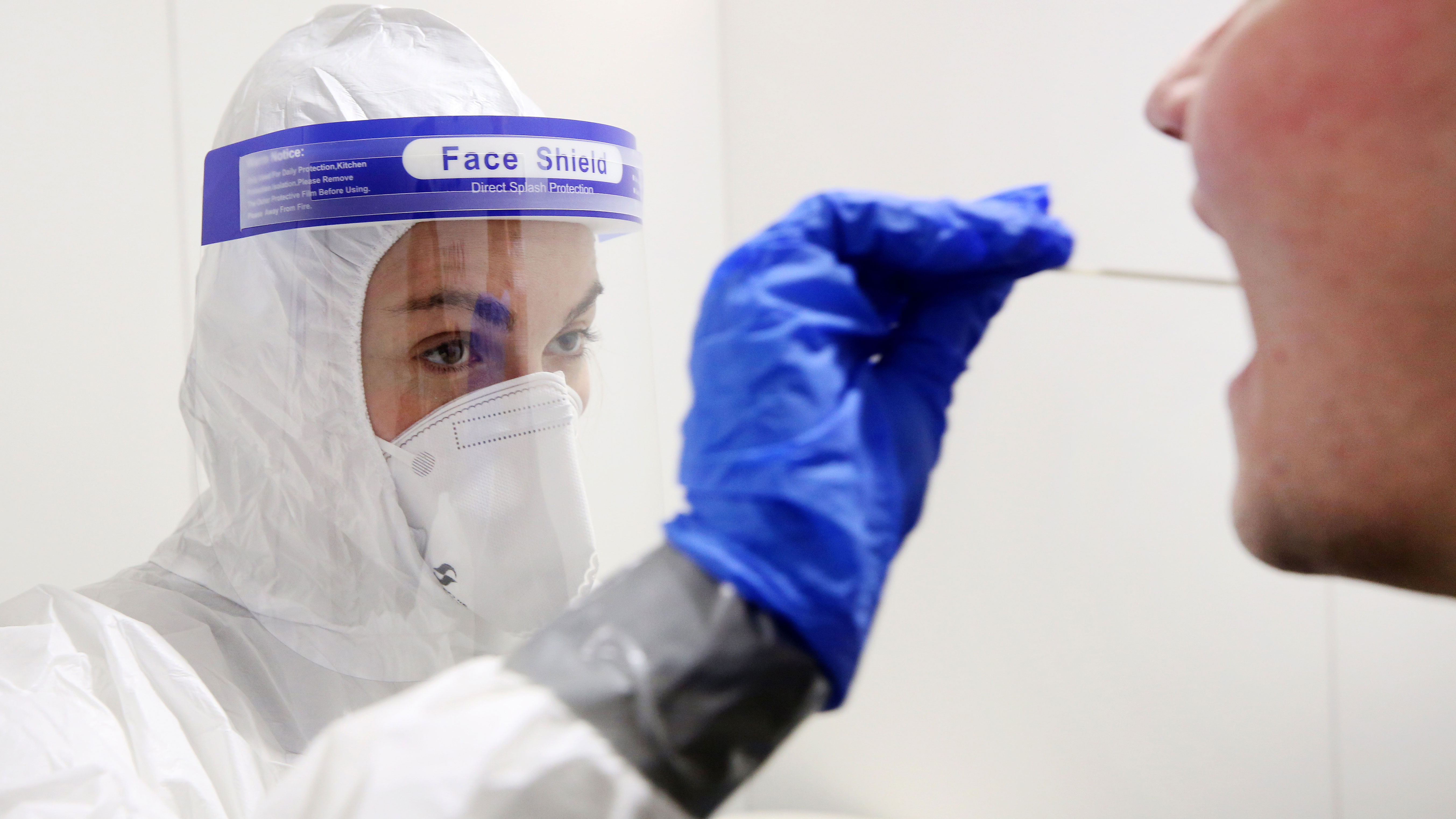 A doctor administers a rapid coronavirus test in Oberhausen, Germany, on December 3.