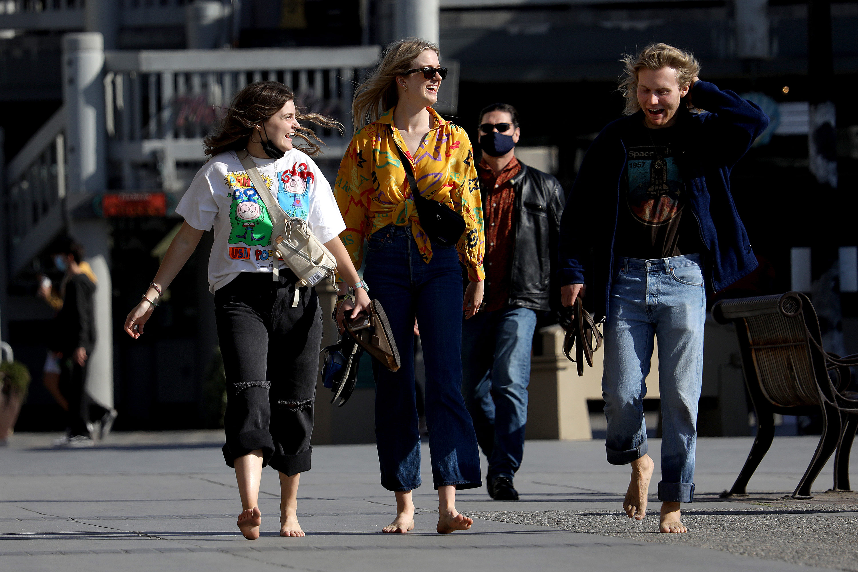 People walk along the boardwalk in Redondo Beach, California, on Tuesday, April 27.