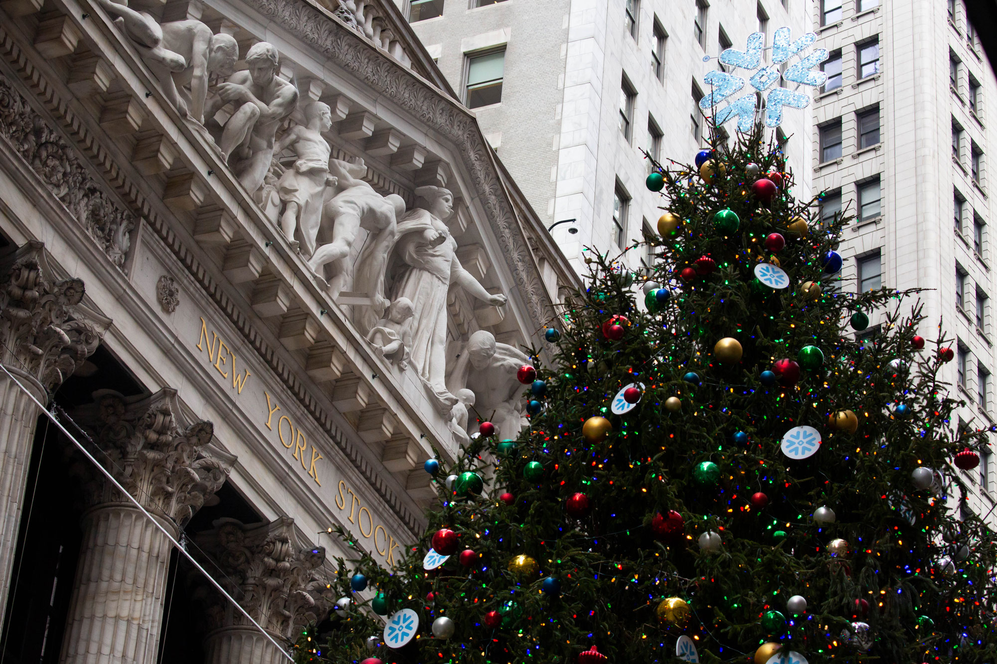 A Christmas tree stands in front of the New York Stock Exchange in New York City on December 9.