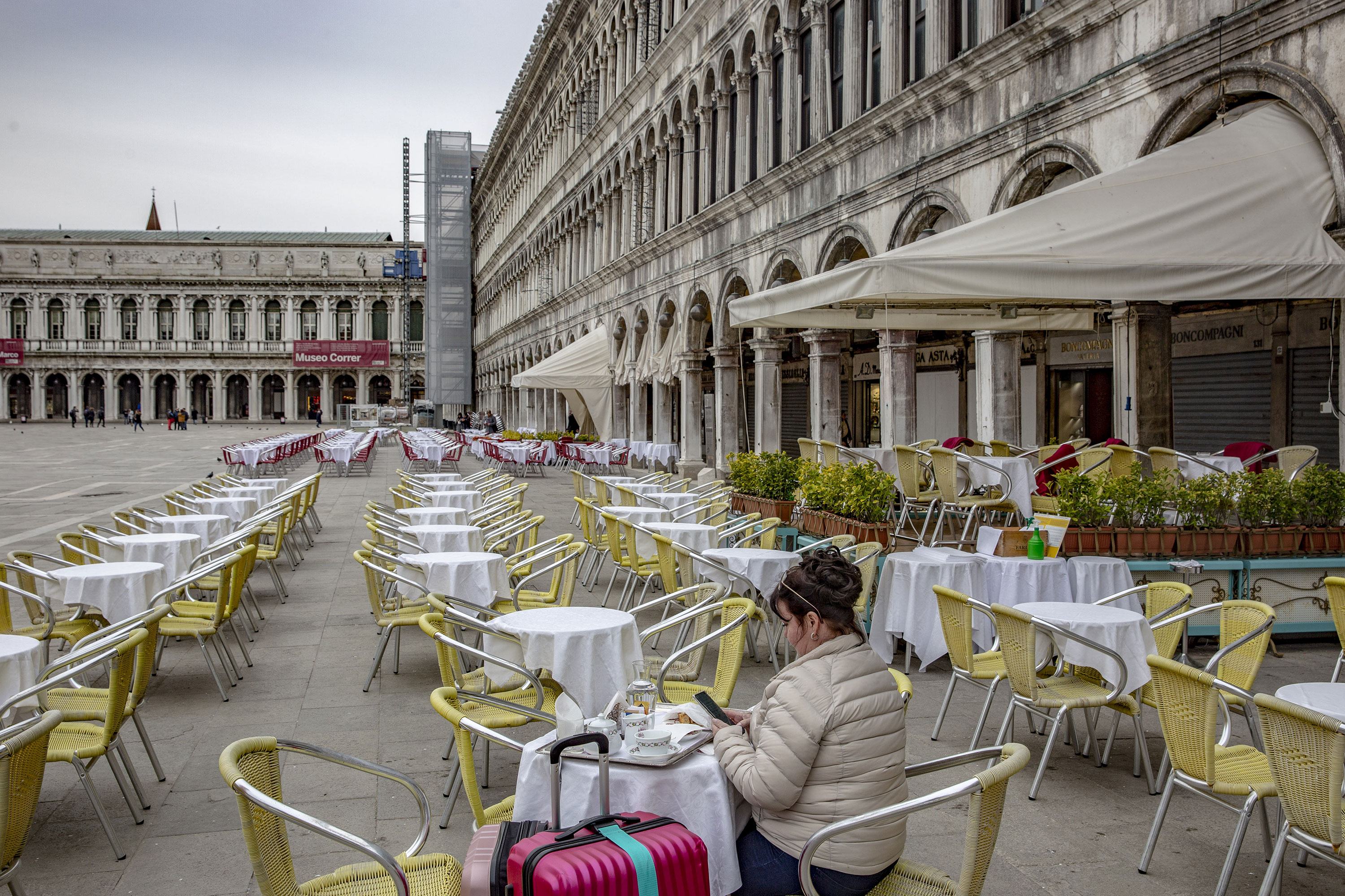 A tourist sits at a restaurant in San Marco Square in Venice, Italy, on Thursday, March 5.