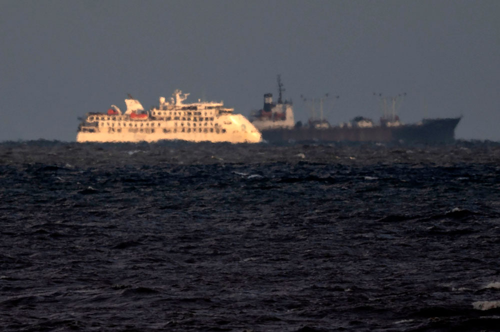 View of Australian cruise ship Greg Mortimer and a ship of the Uruguayan Navy off the port of Montevideo on April 6.