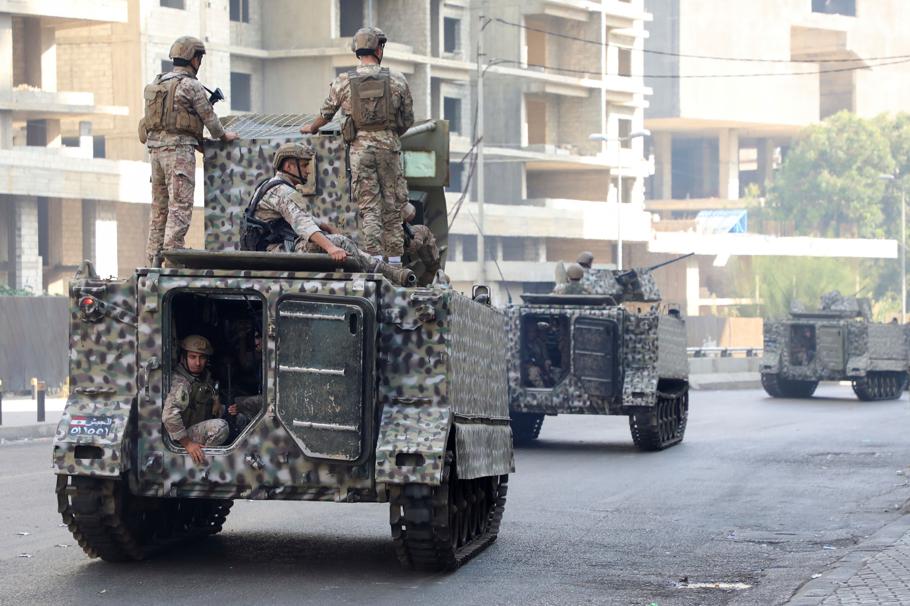 Lebanese soldiers patrol a street after the gunfire erupted.
