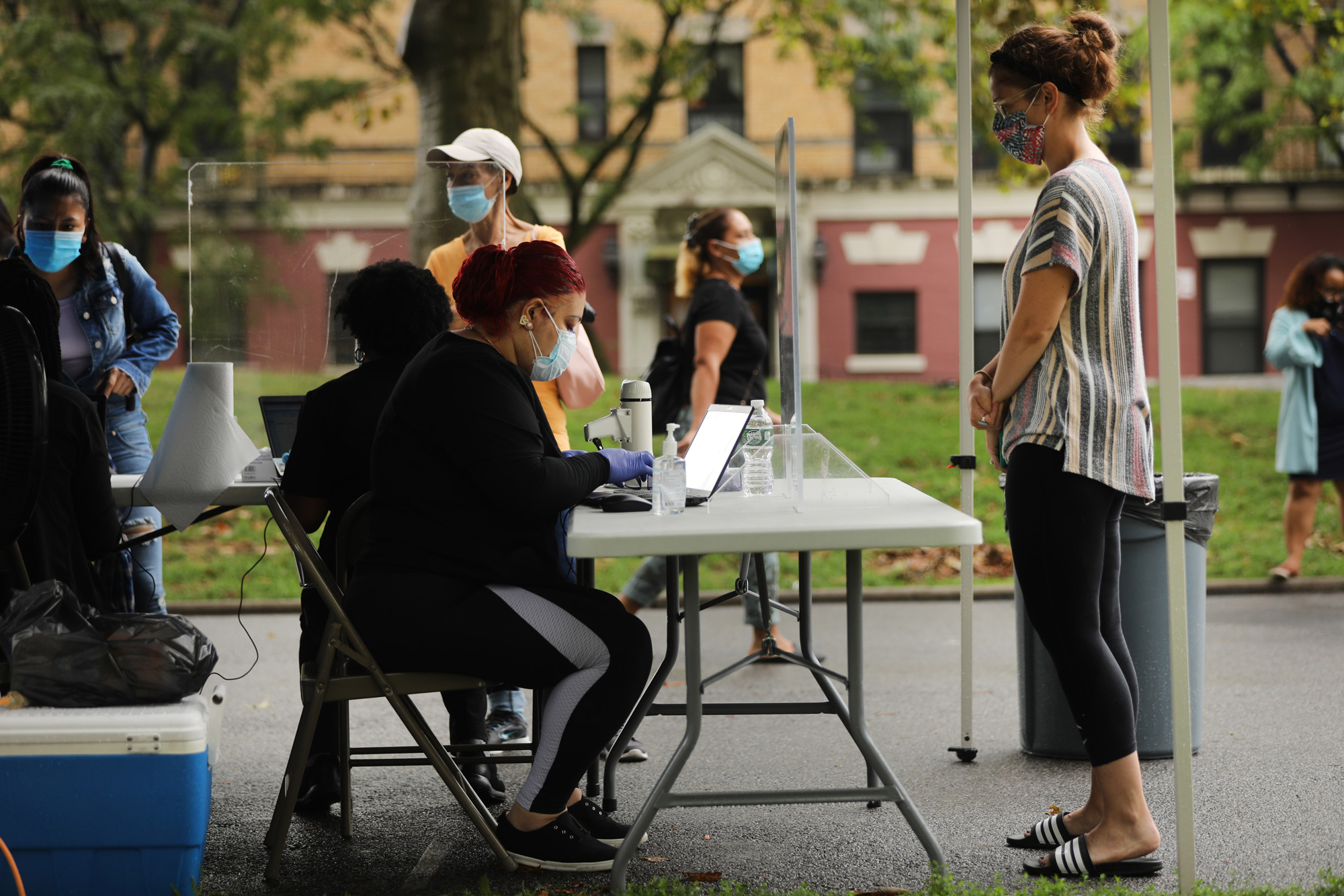 People line-up to take a Covid-19 test in the Sunset Park neighborhood on August 13 in New York City.