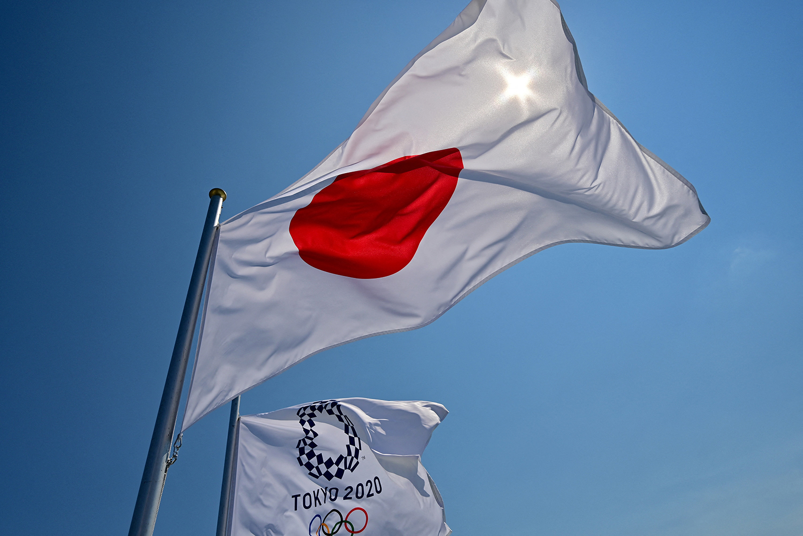 Japanese and Tokyo 2020 Olympic flags wave at the Aomi Urban Sports Park ahead of the Olympic Games in Tokyo on July 22.