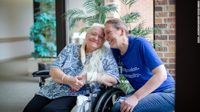 Sisters Doris Crippen, a Covid-19 survivor, left, and Bev Boro, a Dunklau Gardens medication aide, talk about their reunion in Fremont, Nebraska on July 22.