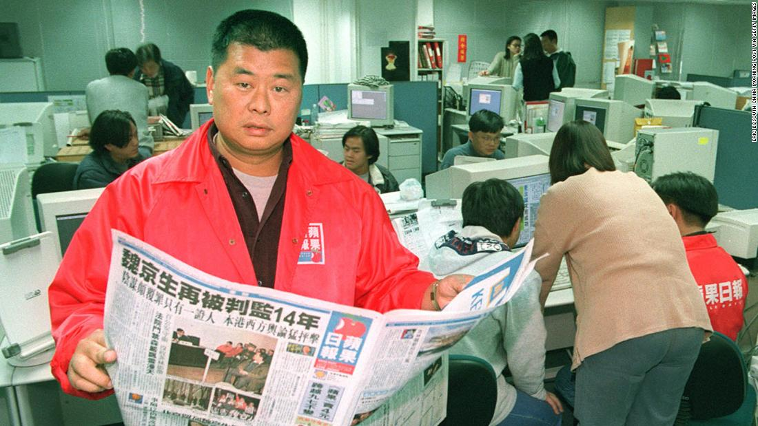Jimmy Lai with his Chinese-language Apple Daily newspaper which sparked a price war when it launched in 1995.