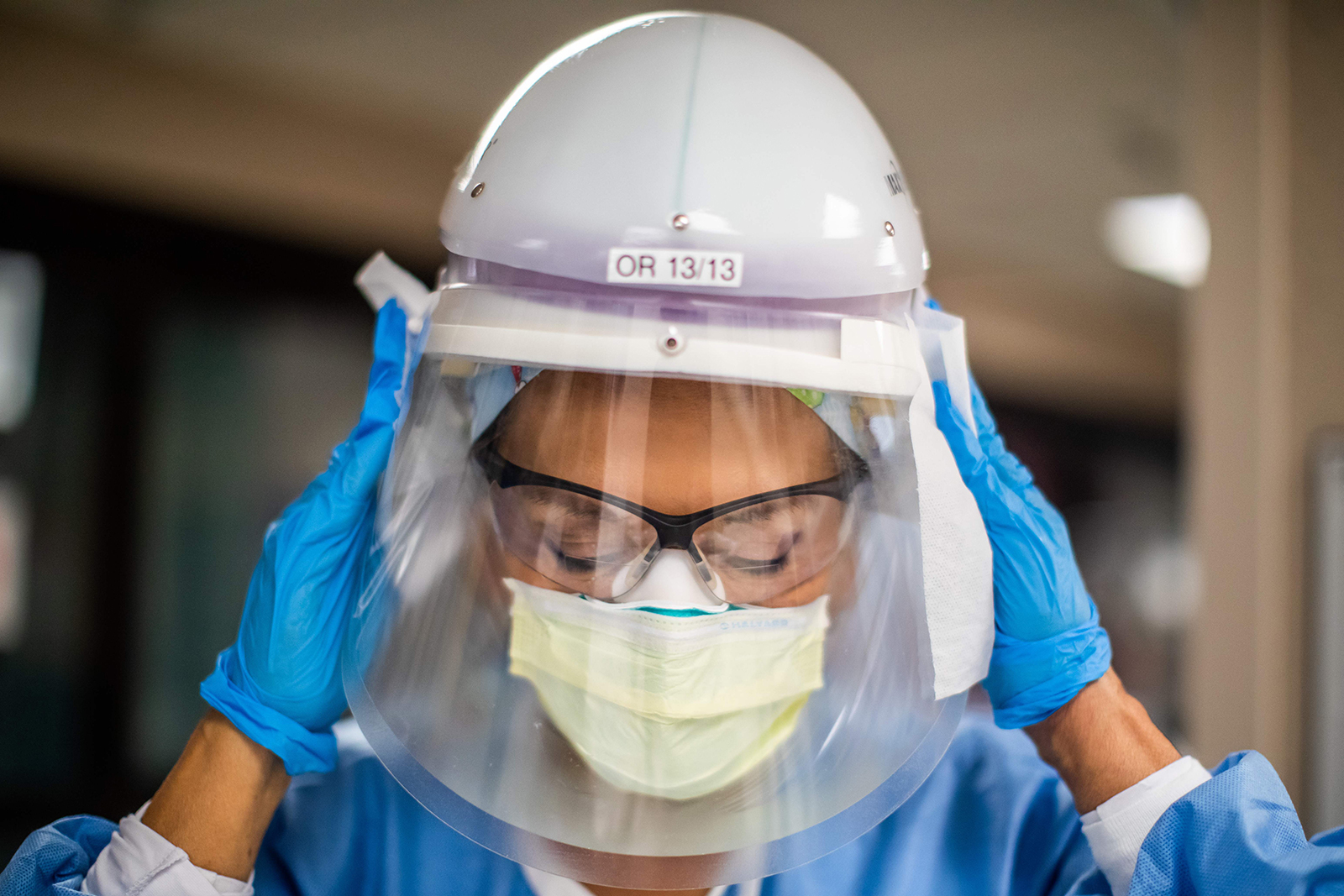 Registered nurse Carmen Verano wipes her CAPR helmet after attending to a Covid-19 patient in the Intensive Care Unit at Providence Cedars-Sinai Tarzana Medical Center in Tarzana, California on December 18.