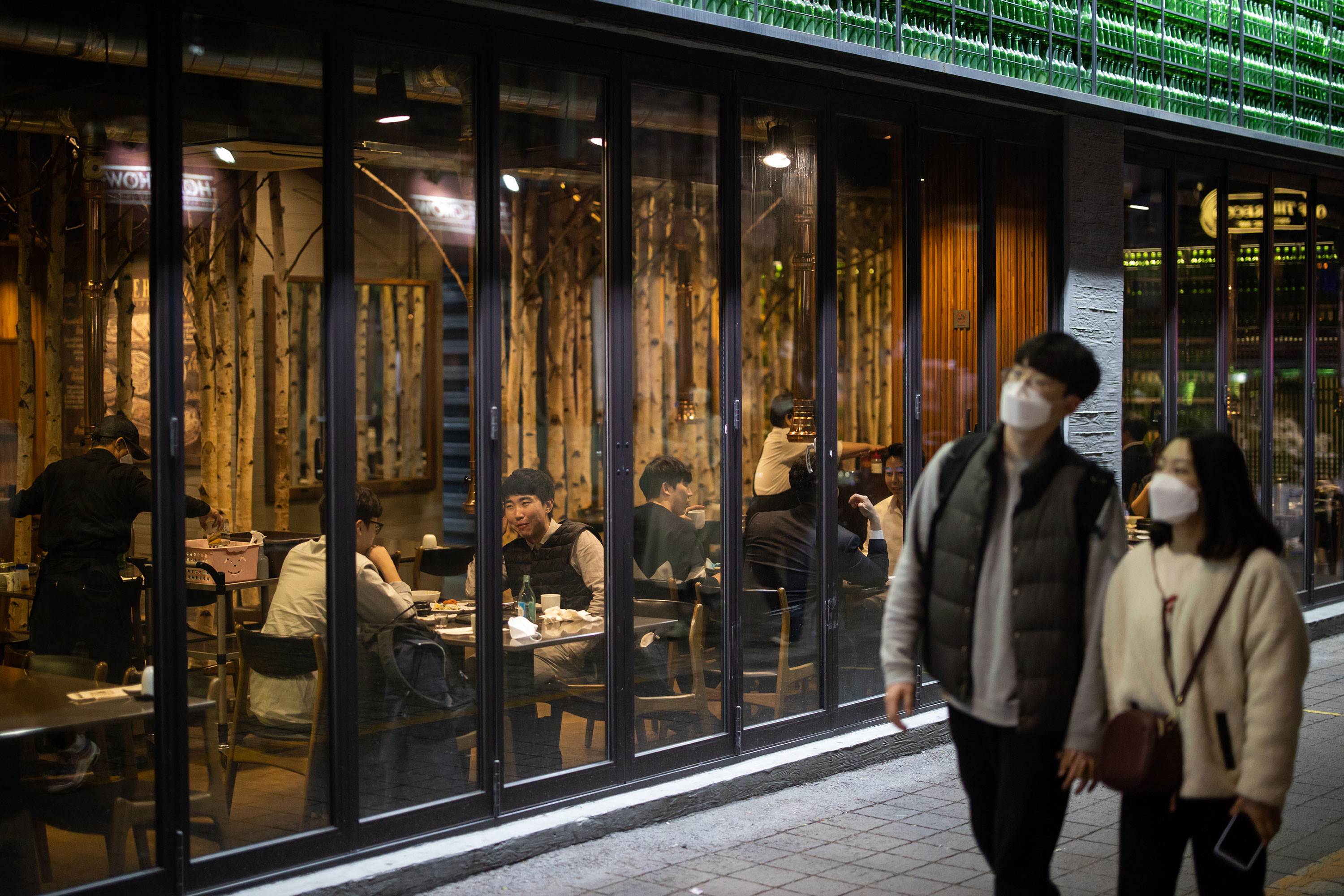 People walk past a restaurant in the Itaewon district in Seoul, South Korea, on April 24.