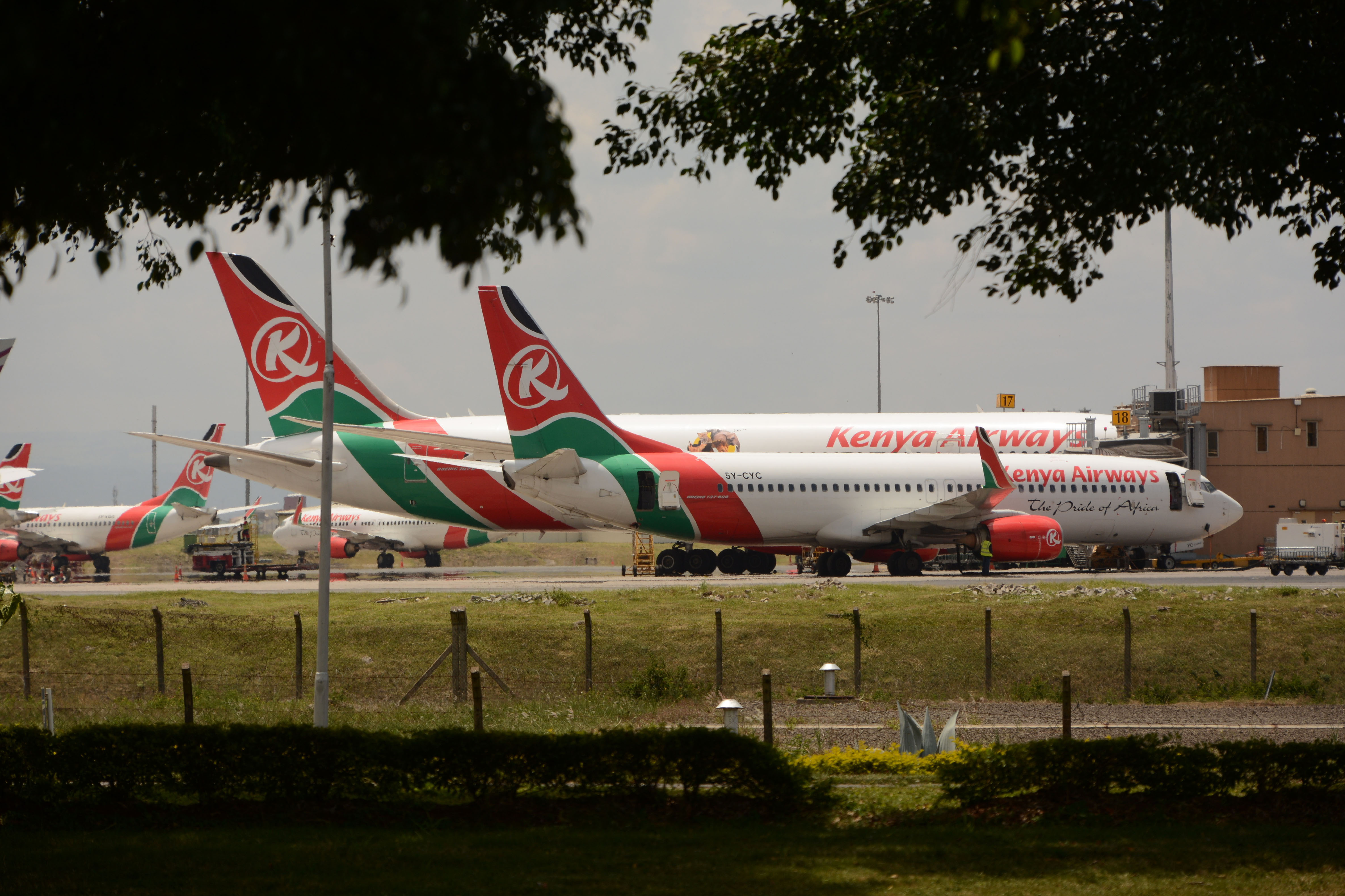 Kenya Airways planes are parked at Jomo Kenyatta International Airport in Nairobi on March 25.