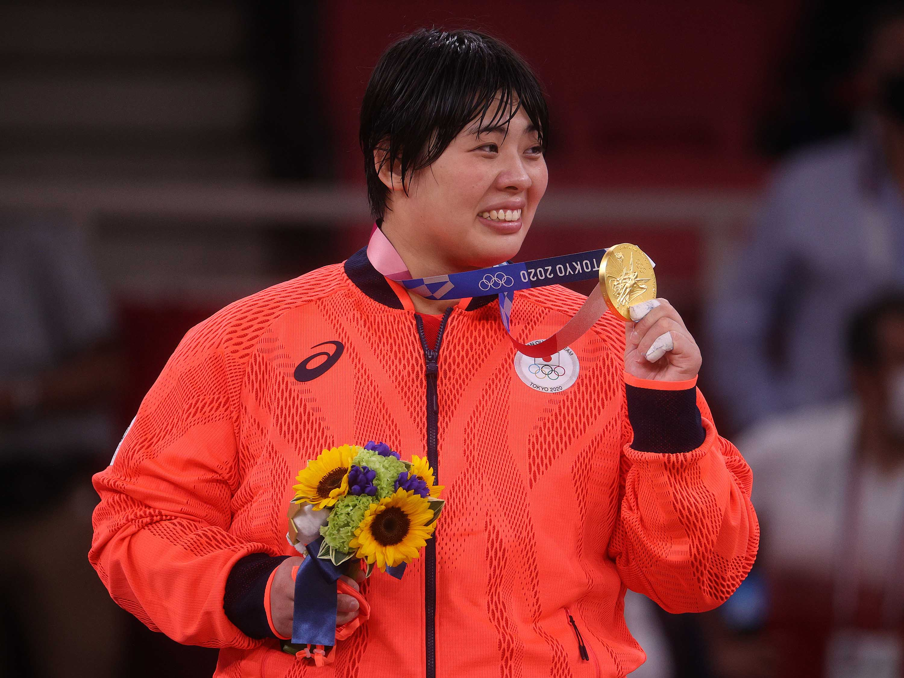 Sone Akira of Team Japan poses with the gold medal for the women's judo 78kg event on July 30, in Tokyo.