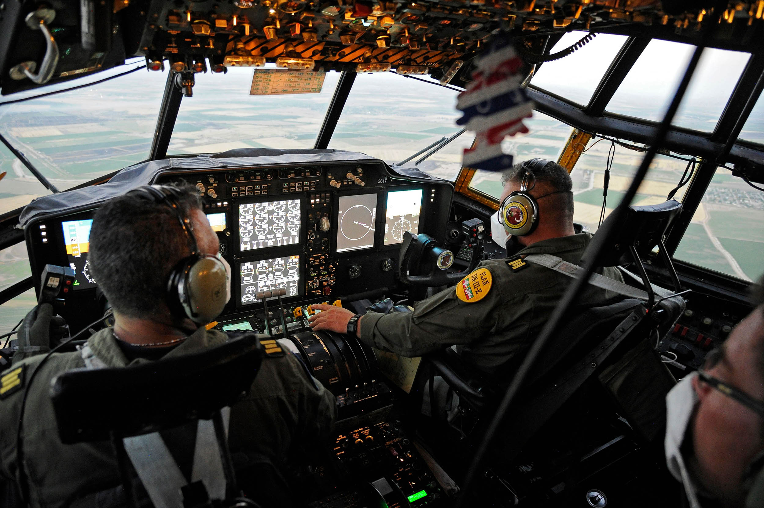 Mexican Air Force pilots fly a C-130 airplane to transport medical supplies to Hermosillo, Mexico on July 3.