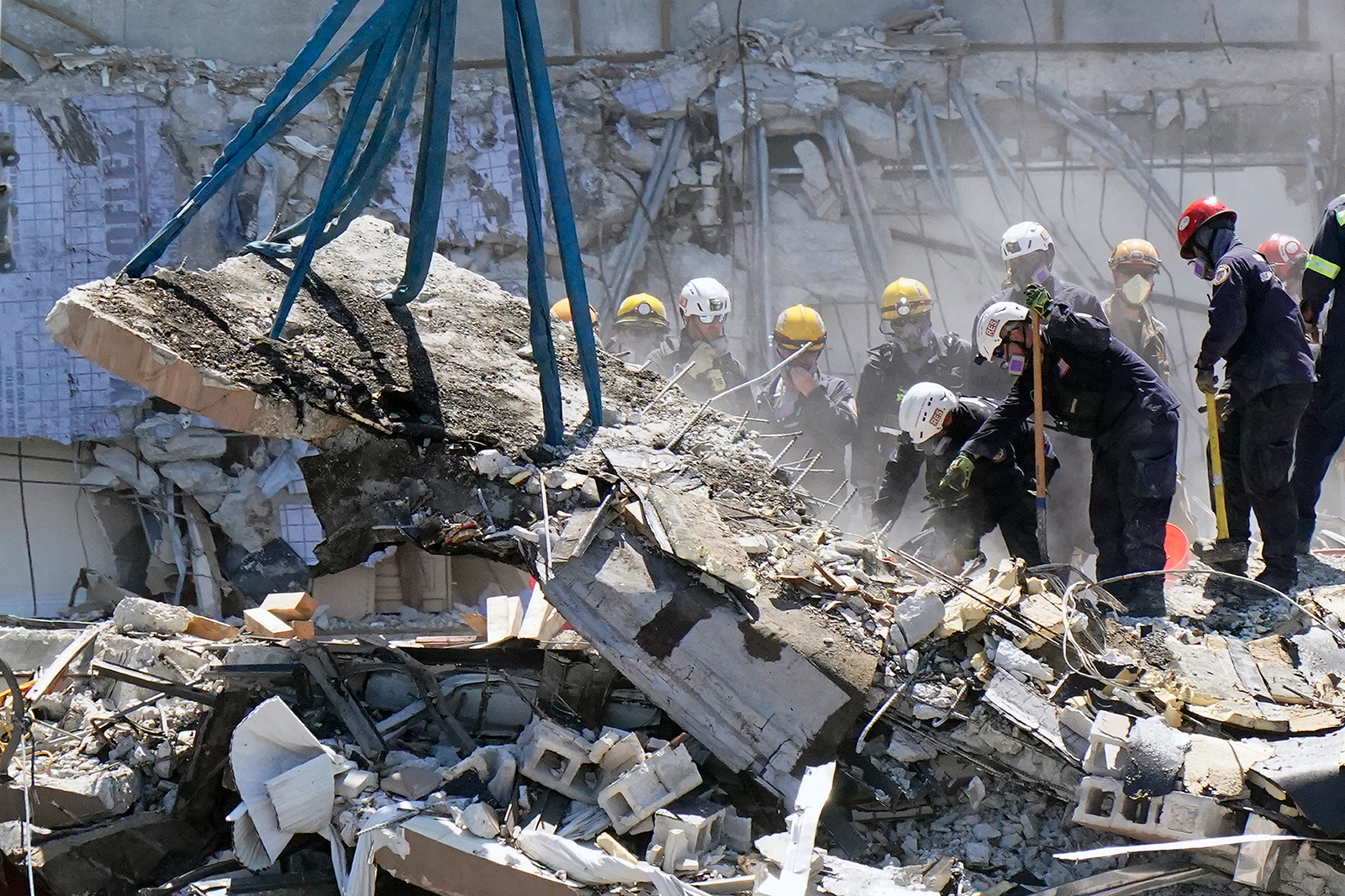 Crews work in the rubble at the Champlain Towers South Condo, Sunday, June 27, in Surfside, Florida.