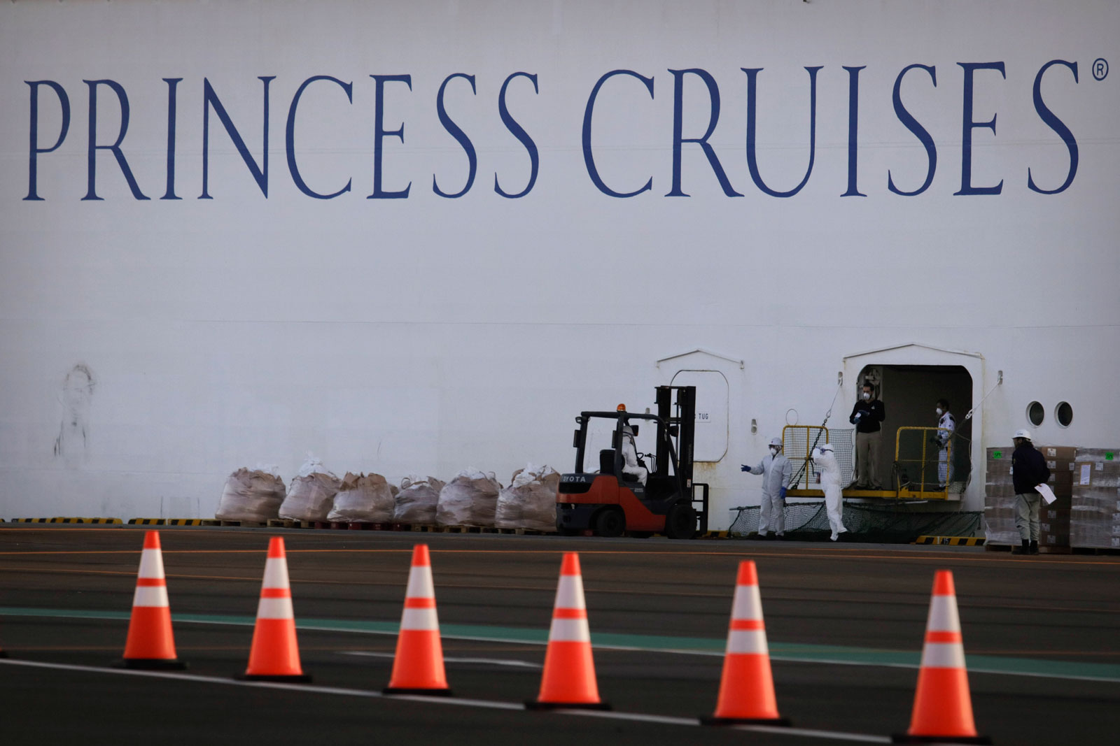 Workers load supplies onto the quarantined Diamond Princess cruise ship Thursday, February 13, in Yokohama, Japan.