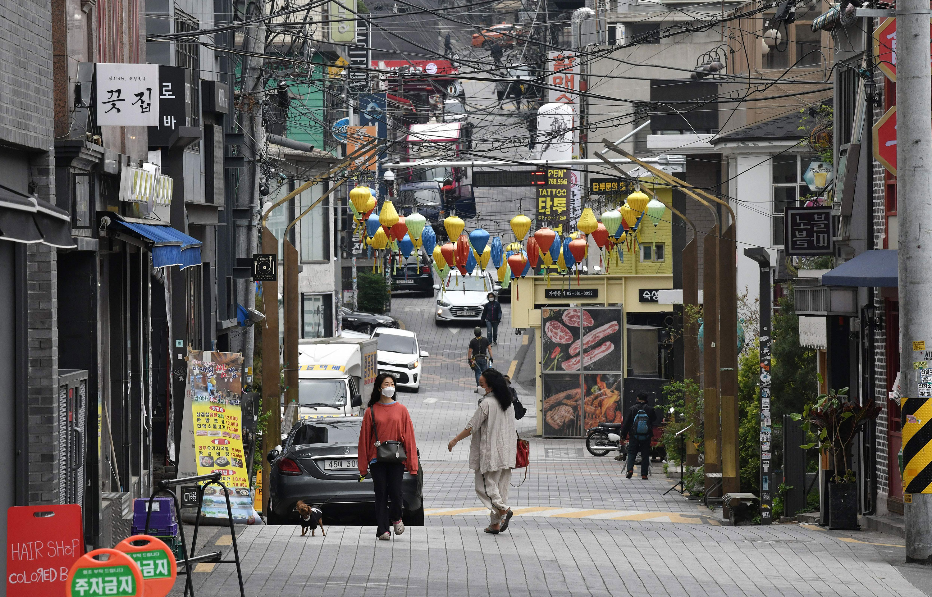 Pedestrians walk through in the nightlife district of Itaewon on May 12 in Seoul, South Korea.