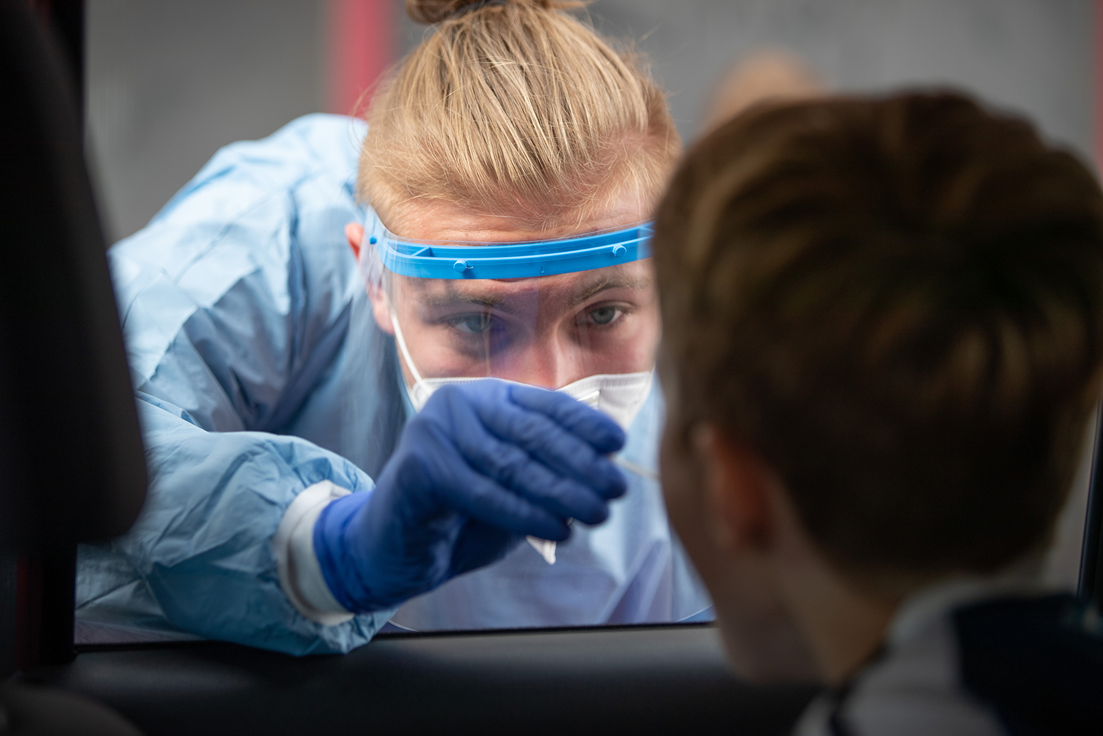 A rescue worker takes a swab at a drive-in test centre for students and teachers of several schools in North Rhine-Westphalia, Bielefeld, Germany on August 19.