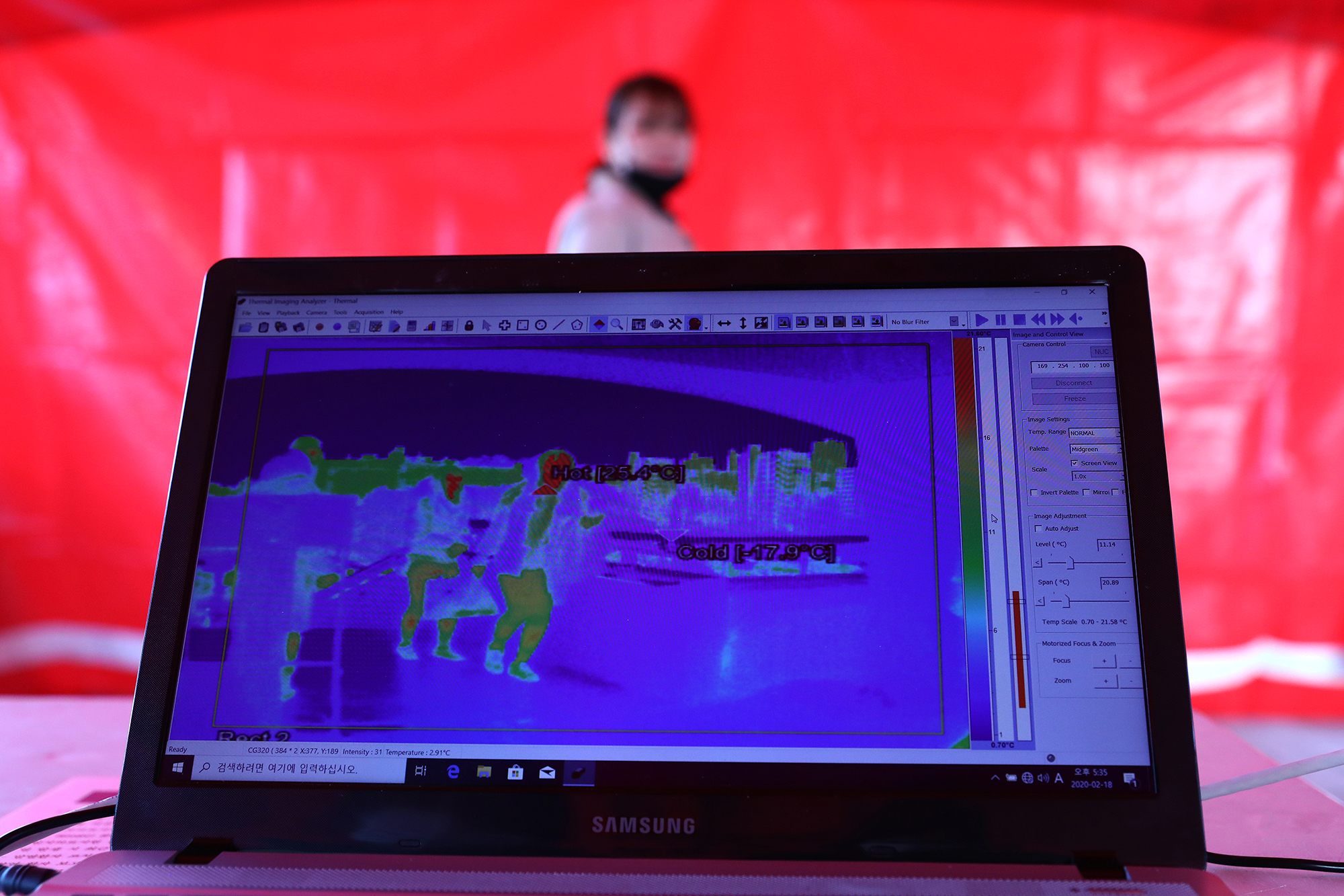 A fan walks past a thermal camera used to look for signs of the coronavirus ahead of the AFC Champions League Group E match between FC Seoul and Melbourne Victory at the Seoul World Cup Stadium on Tuesday, February 18, 2020 in Seoul, South Korea.