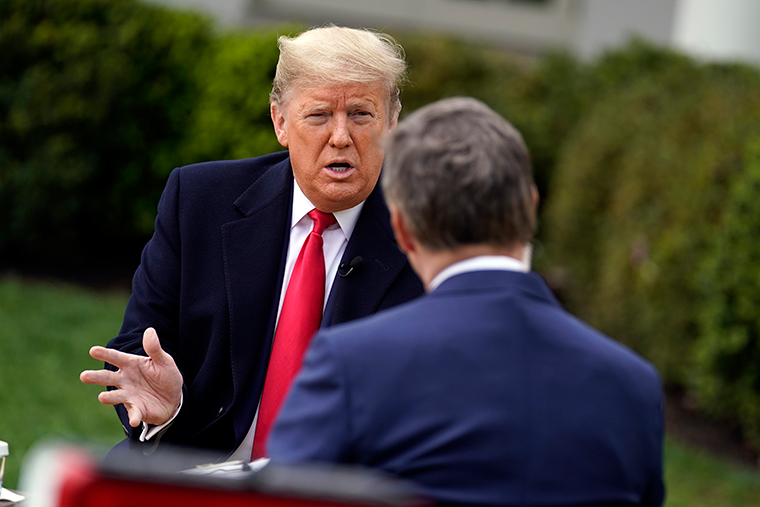 President Donald Trump speaks with Fox News Channel Anchor Bill Hemmer during a Fox News Channel virtual town hall, at the White House, Tuesday, March 24.
