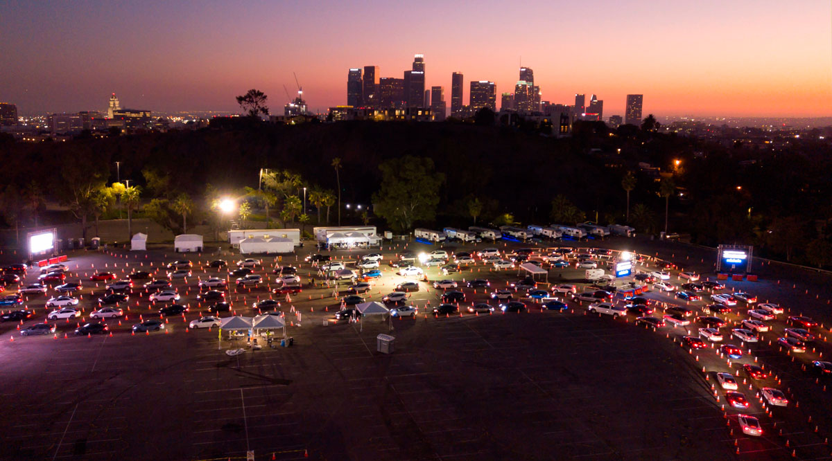 Cars line up at the Dodger Stadium parking lot for Covid-19 testing while the downtown Los Angeles skyline is seen in the distance, in Los Angeles, California, on November 14.