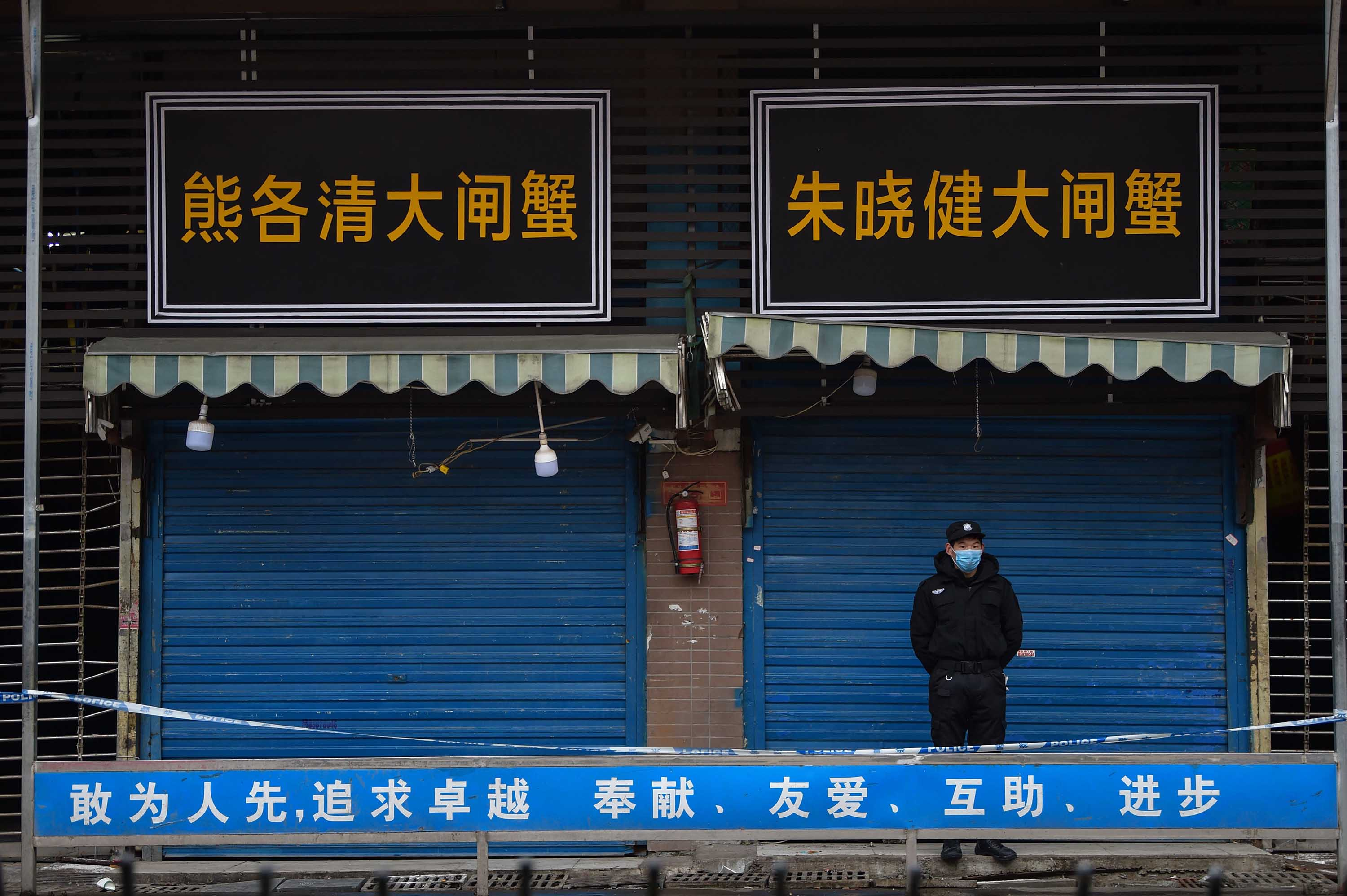 A security guard stands outside the Huanan Seafood Wholesale Market in Wuhan, China on January 24, 2020, where the coronavirus was detected in the early days of the outbreak.