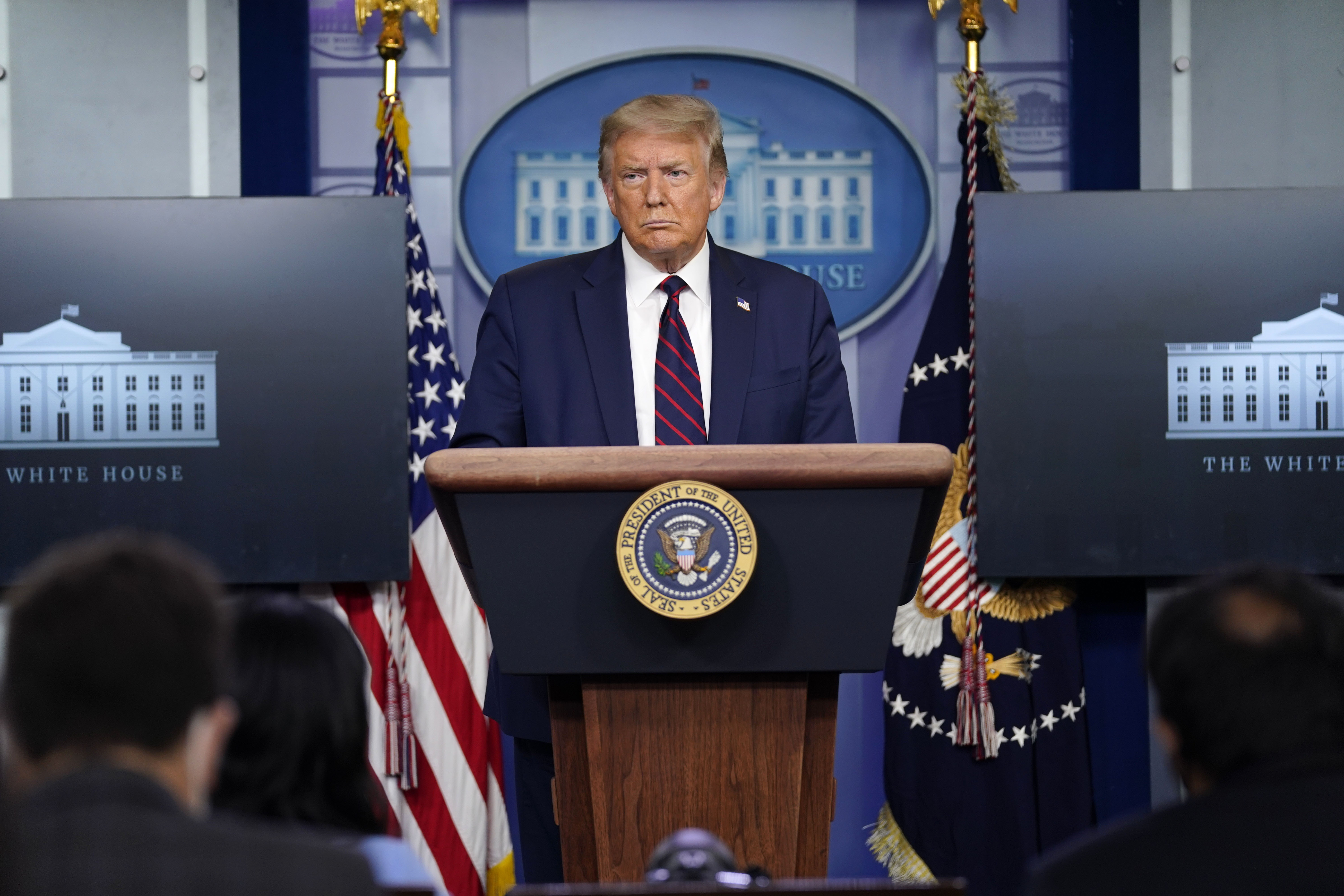 President Donald Trump holds a coronavirus briefing at the White House on July 21.