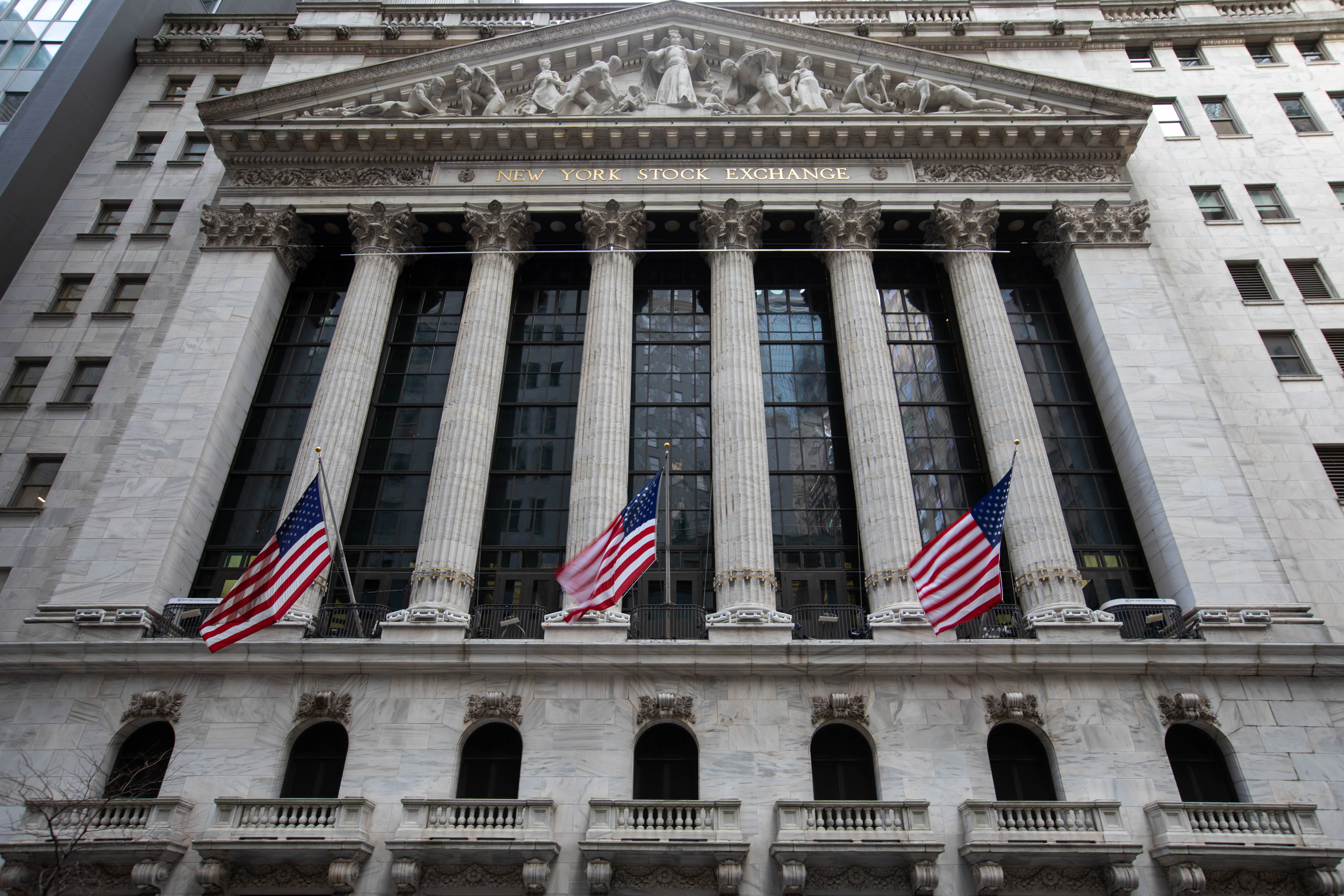 American flags fly outside the New York Stock Exchange on Monday.