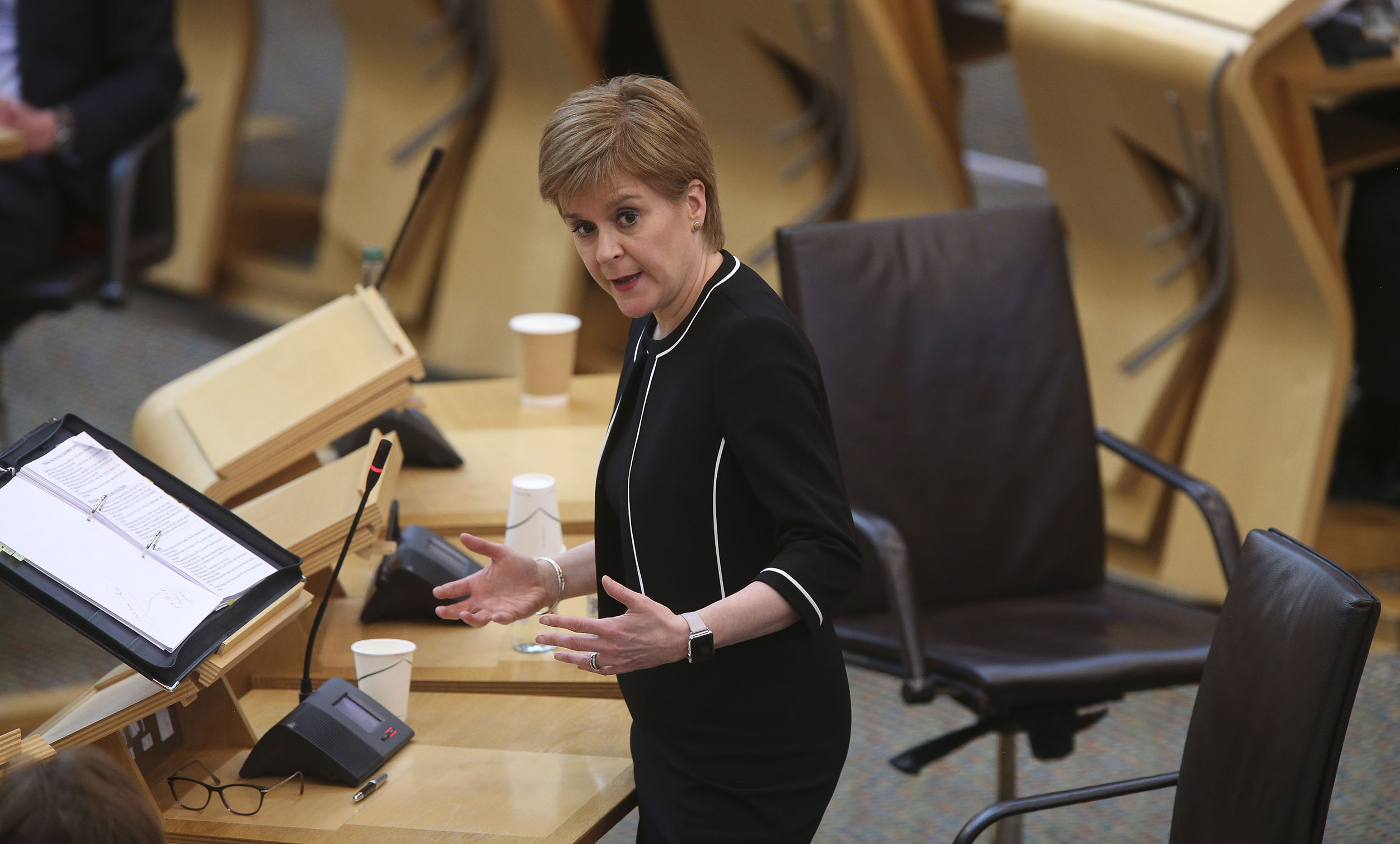 Scotland's First Minister Nicola Sturgeon speaks during First Minster's Questions (FMQ's) in the debating chamber of the Scottish Parliament in Edinburgh on April 28.
