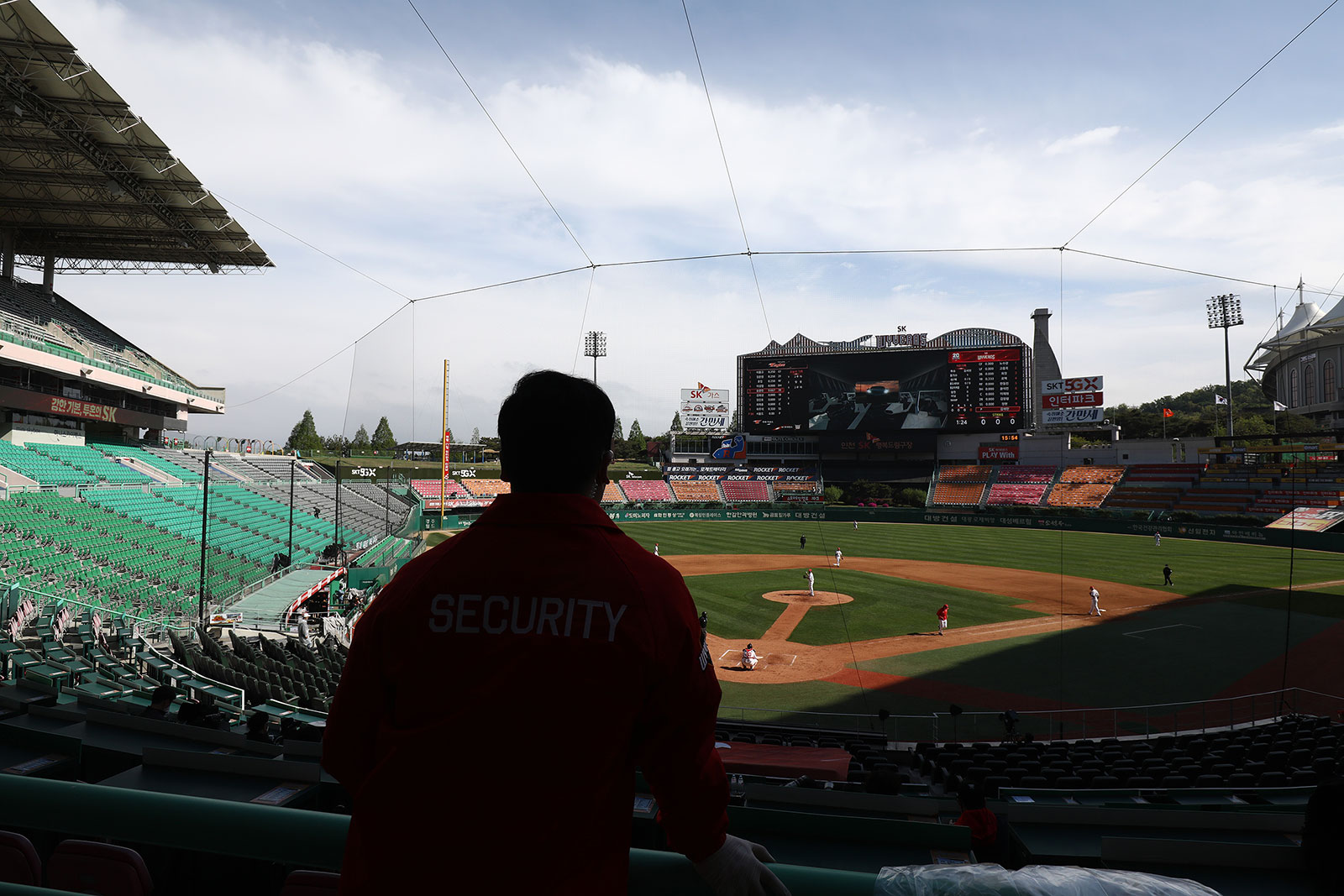A security guard watches a KBO baseball game between the SK Wyverns and Hanwha Eagles in Incheon, South Korea, on May 5.