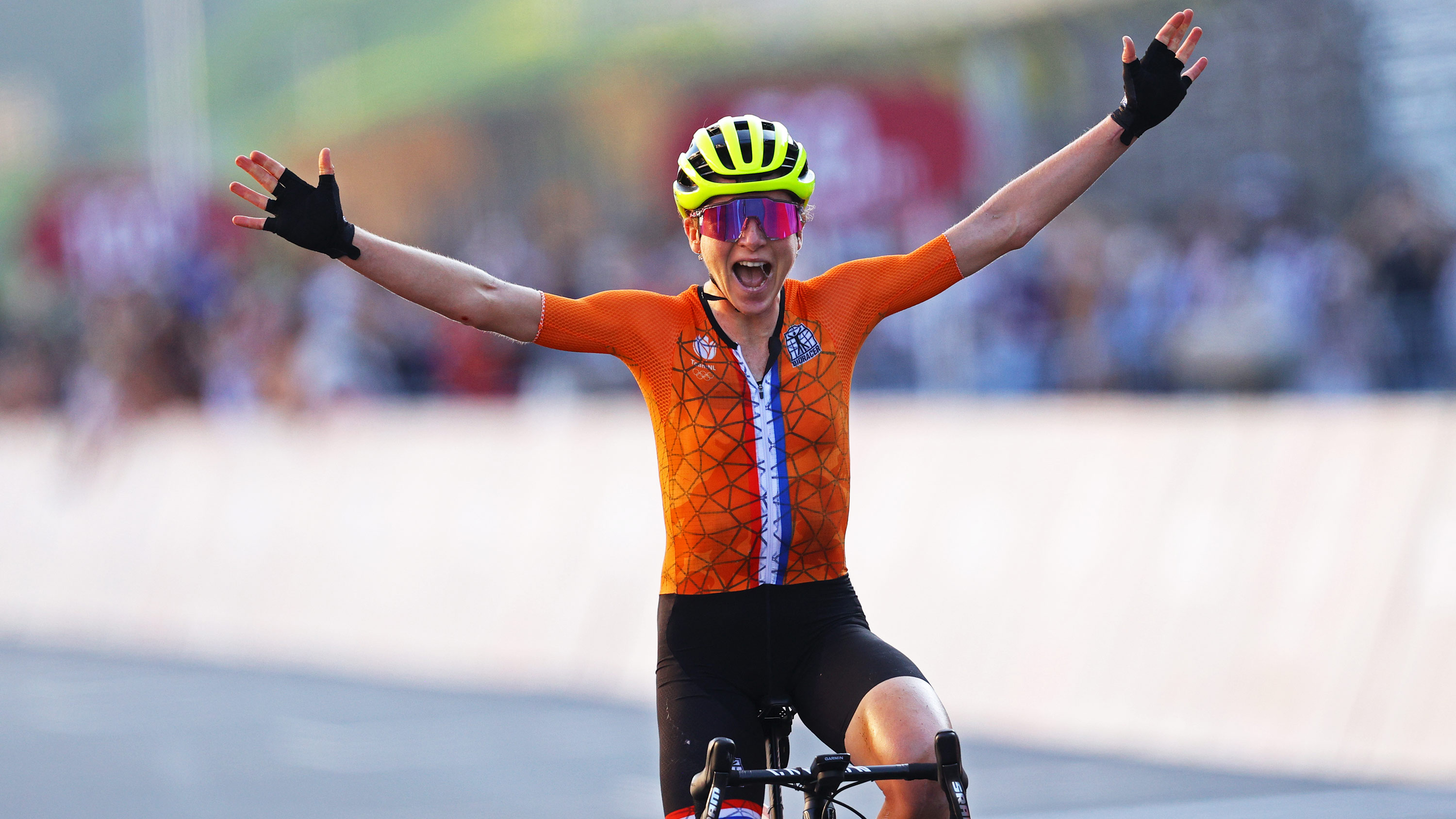 Annemiek van Vleuten of Team Netherlands celebrates while crossing the finishing line winning the silver medal in the road race on July 25.