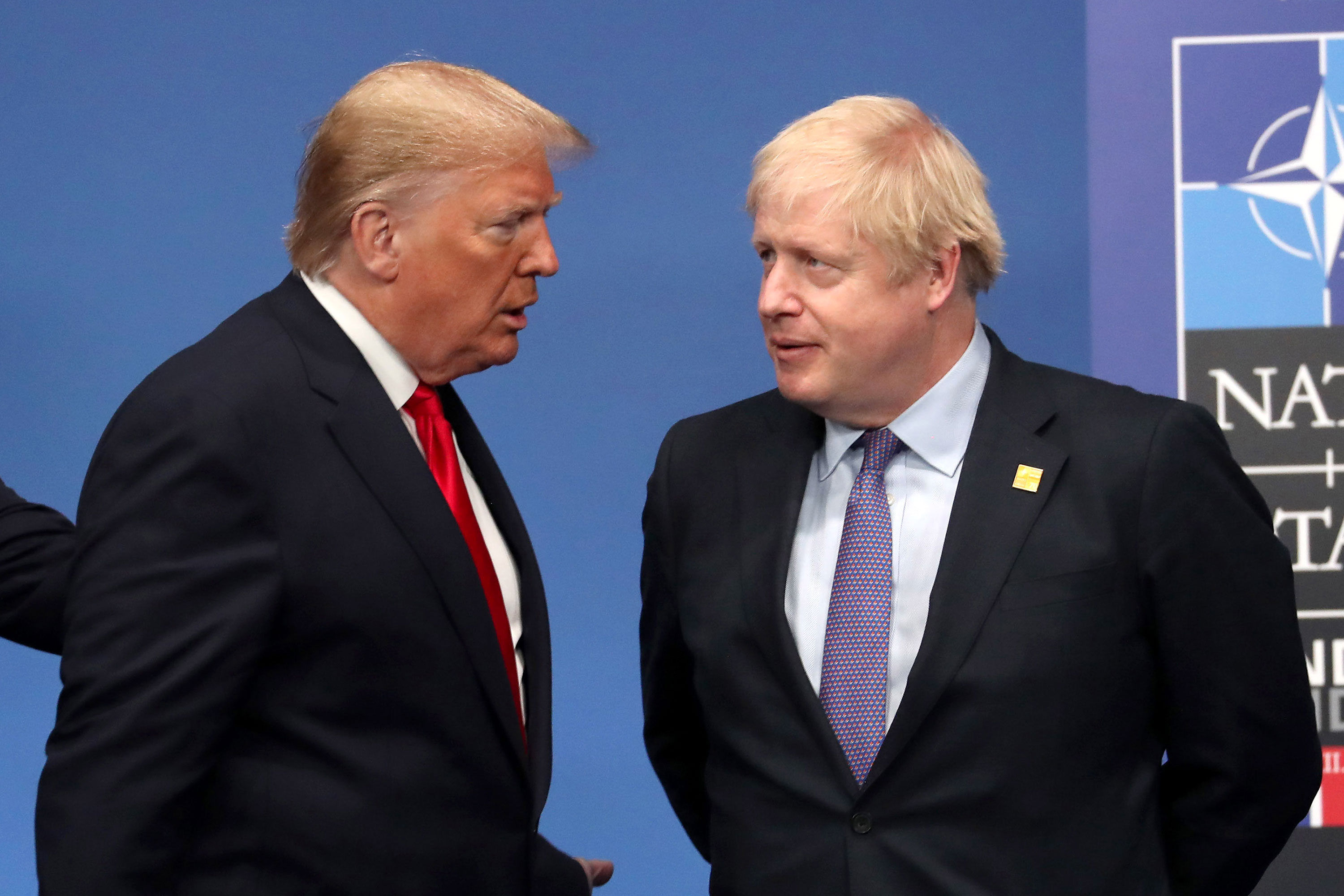 In this file photo, US President Donald Trump and British Prime Minister Boris Johnson speak during the annual NATO heads of government summit on December 4, 2019 in Watford, England.