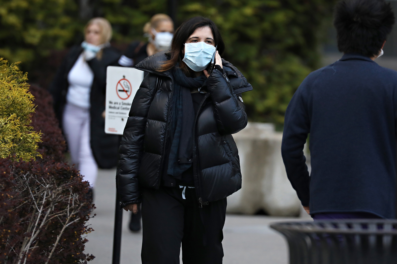 A woman wears a protective mask while talking on a cell phone on April 21 in New York City.